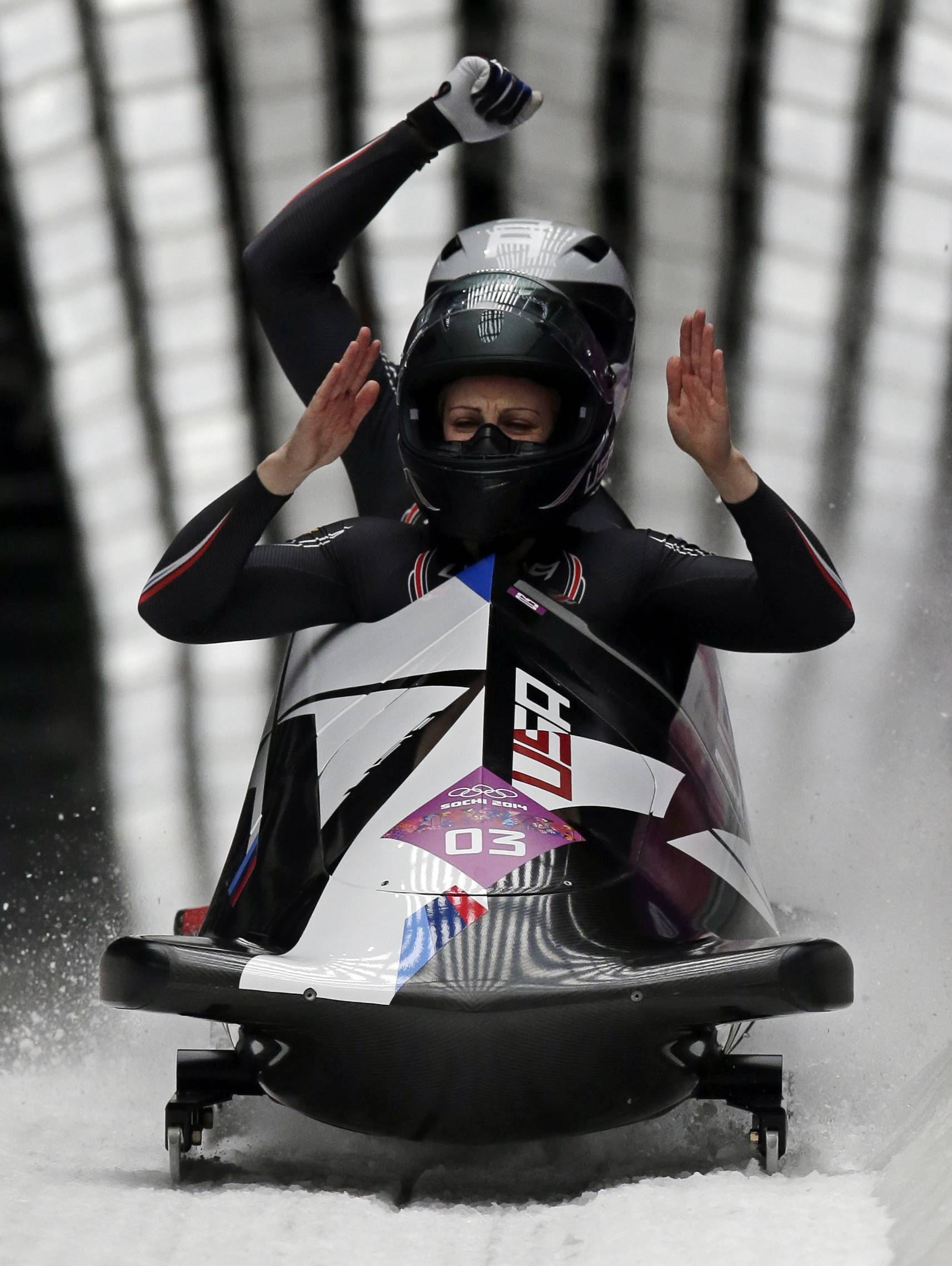 The team from the United States USA-2, piloted by Jamie Greubel with brakeman Aja Evans, cross into the finish area to win the bronze medal in the women's bobsled competition.
