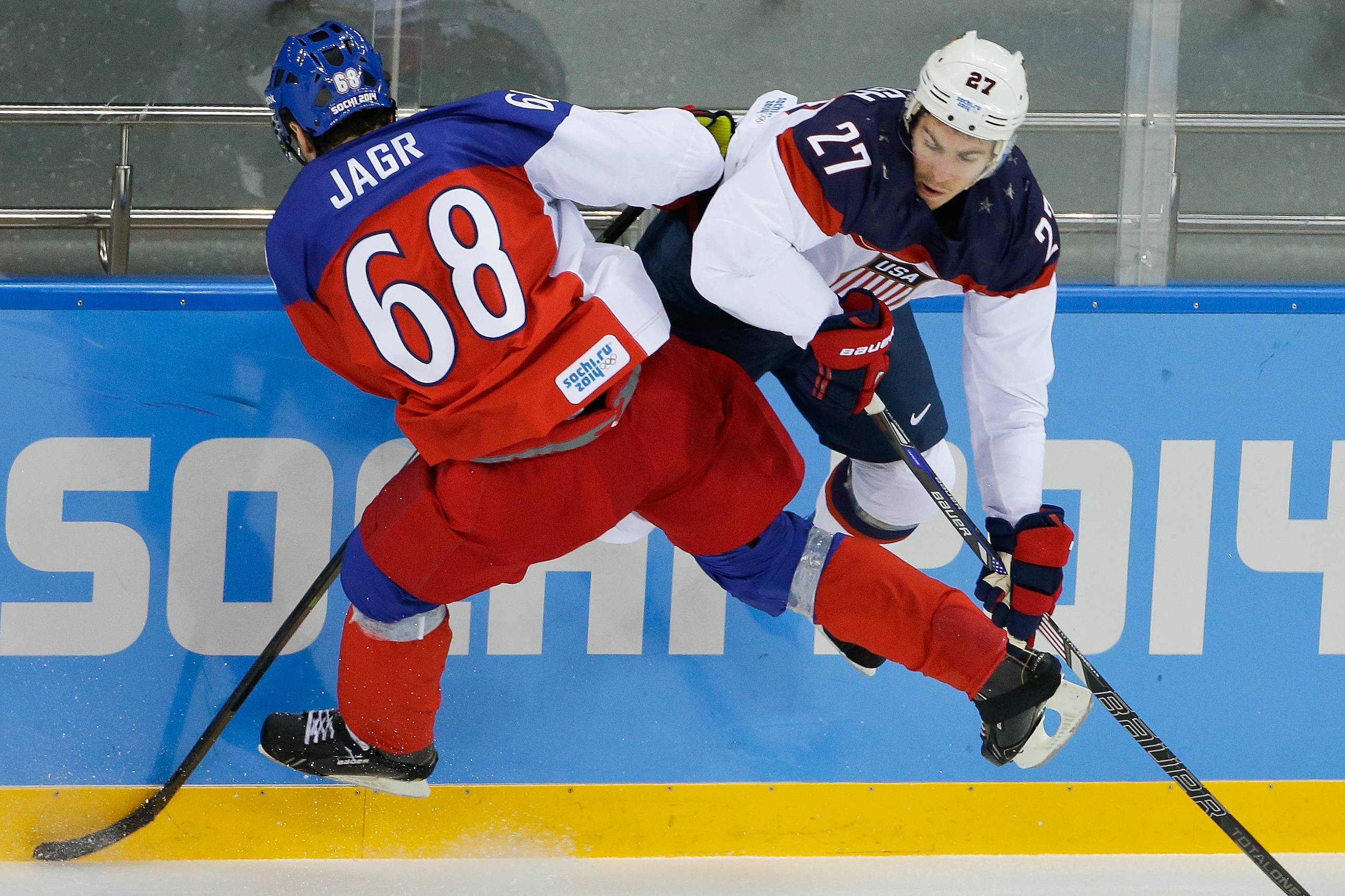 Czech Republic forward Jaromir Jagr and USA defenseman Ryan McDonagh collide during the first period of men's quarterfinal hockey game.