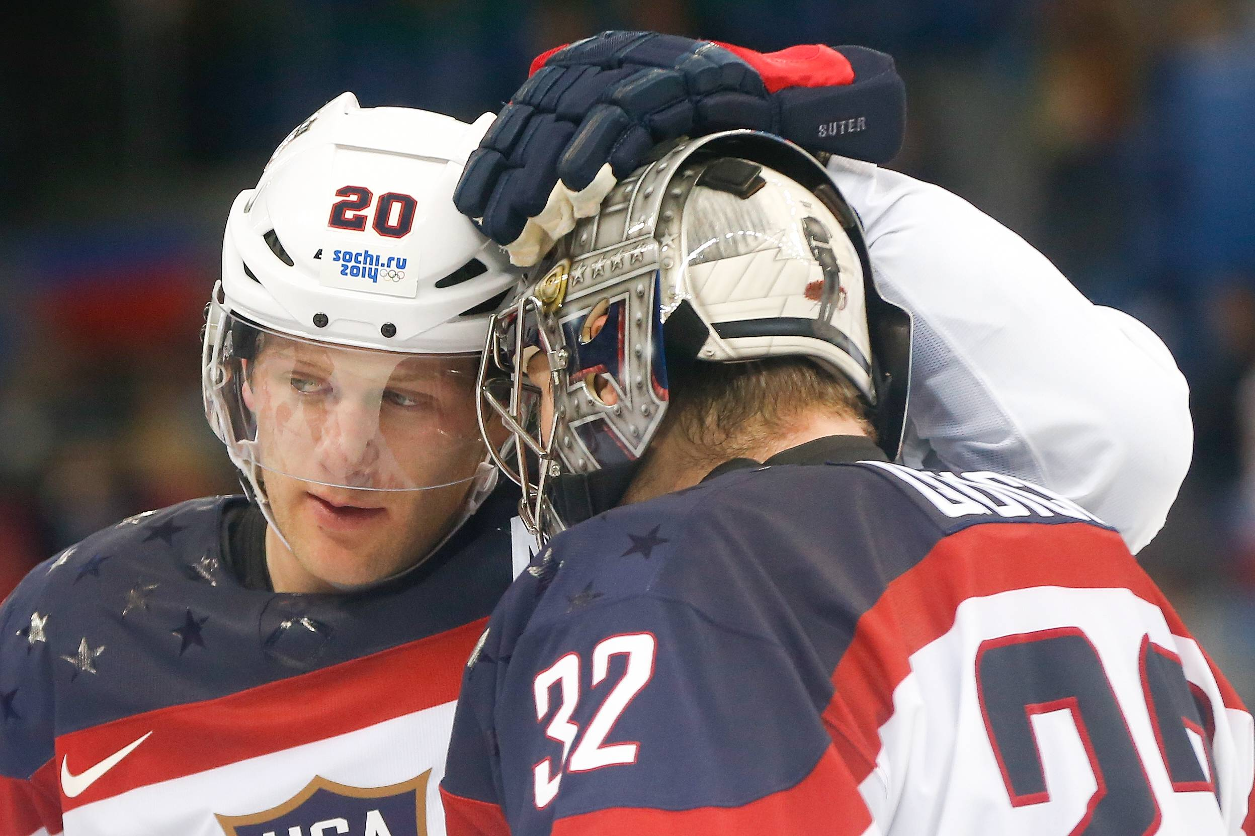 USA defenseman Ryan Suter celebrates Team USA's 5-2 win over the Czech Republic with goaltender Jonathan Quick after the men's quarterfinal hockey game.