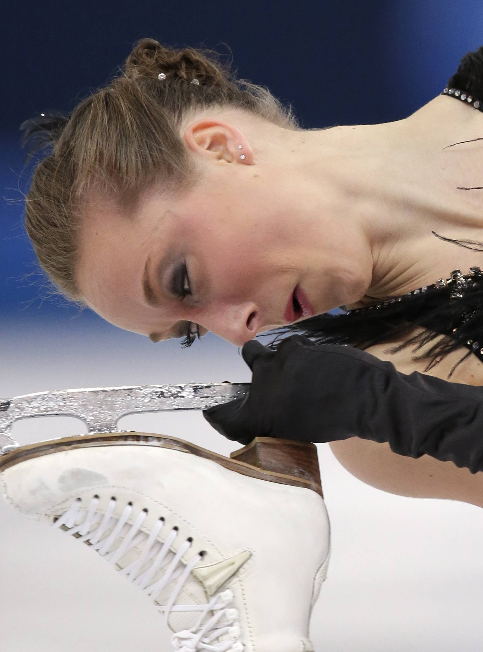 Nathalie Weinzierl of Germany competes in the women's short program figure skating competition.