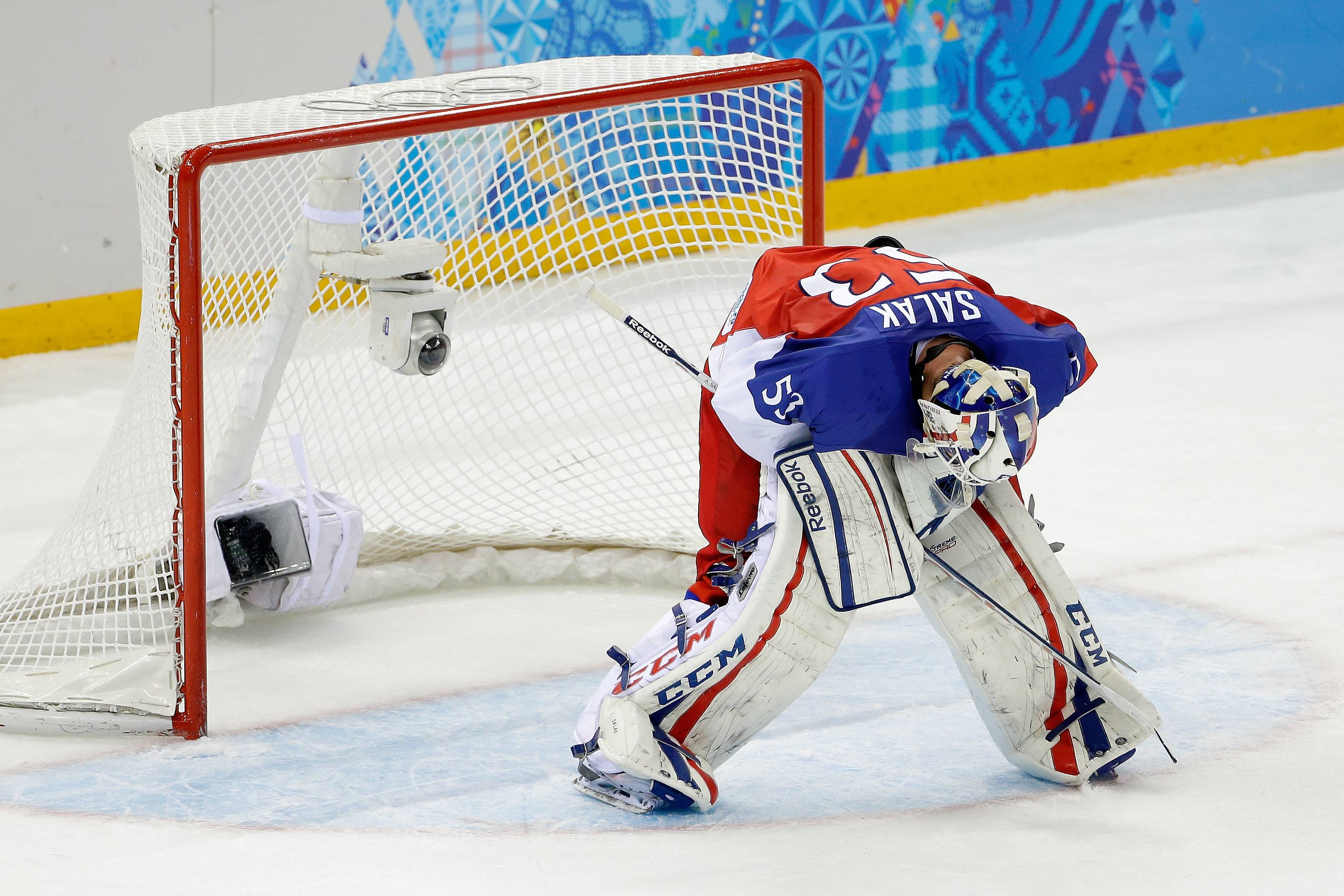 Czech Republic goaltender Alexander Salak looks down at the ice after the team's 5-2 loss to the United States in the men's quarterfinal hockey game.
