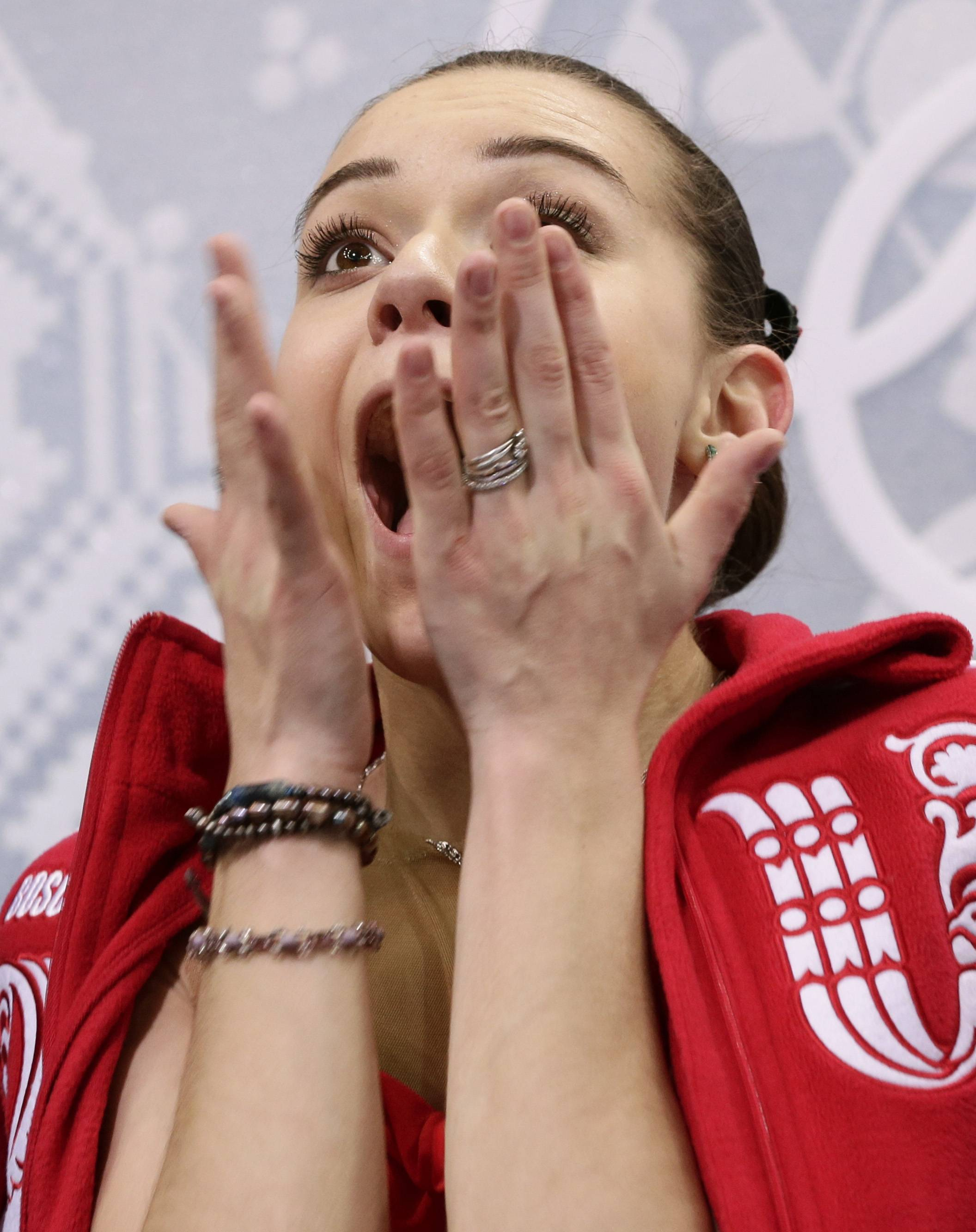 Adelina Sotnikova of Russia reacts as she waits in the results area after completing her routine in the women's short program figure skating competition.