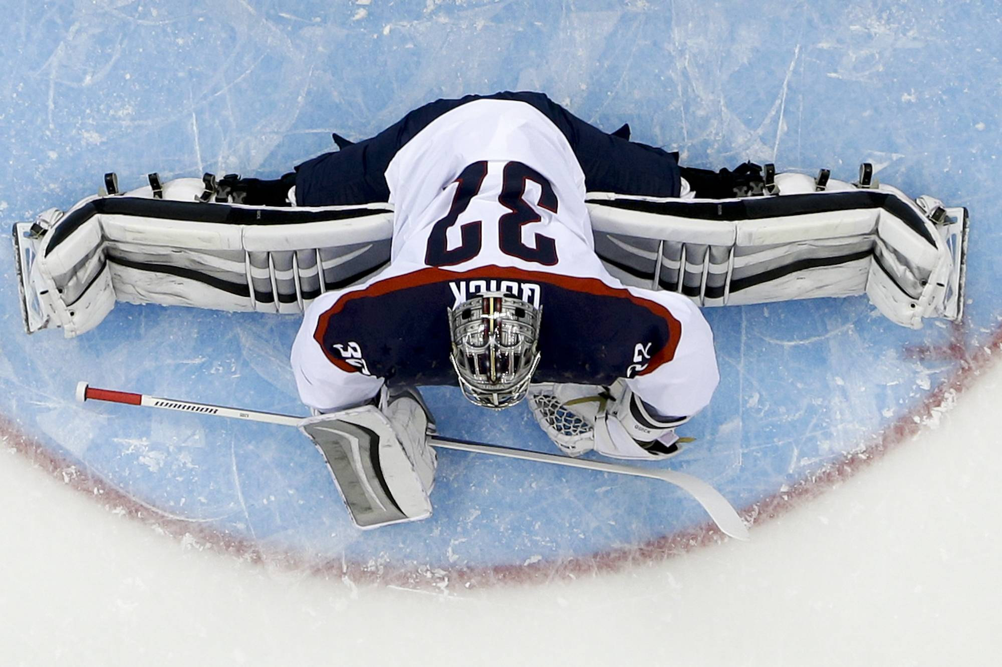 USA goaltender Jonathan Quick stretches tp block a shot on goal during the first period.