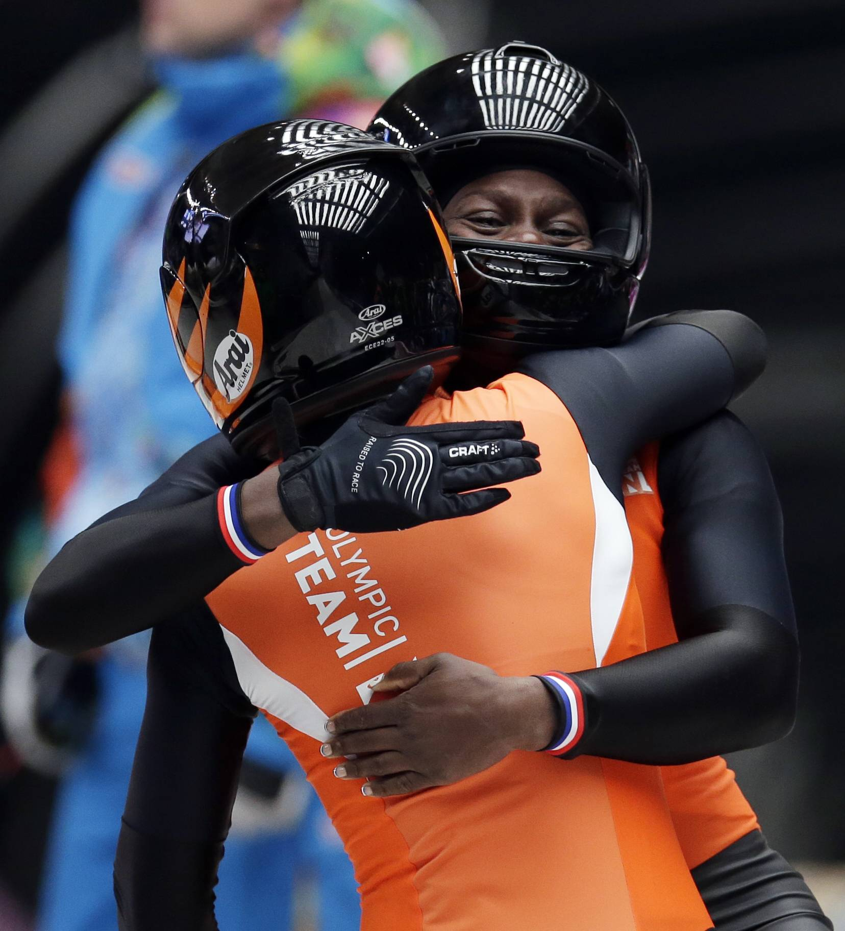 The team from the Netherlands NED-1, piloted by Esme Kamphuis with brakeman Judith Vis, hug after their final run during the women's bobsled competition.