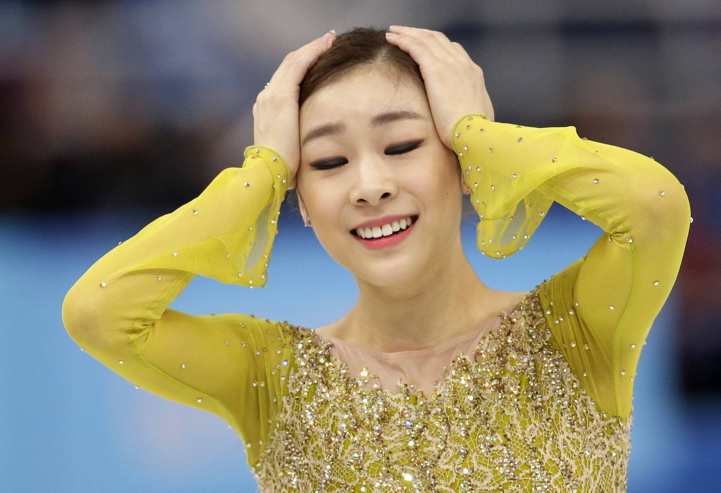 Yuna Kim of South Korea reacts after completing her routine in the women's short program figure skating competition at the Iceberg Skating Palace during the 2014 Winter Olympics, Wednesday, Feb. 19, 2014, in Sochi, Russia.