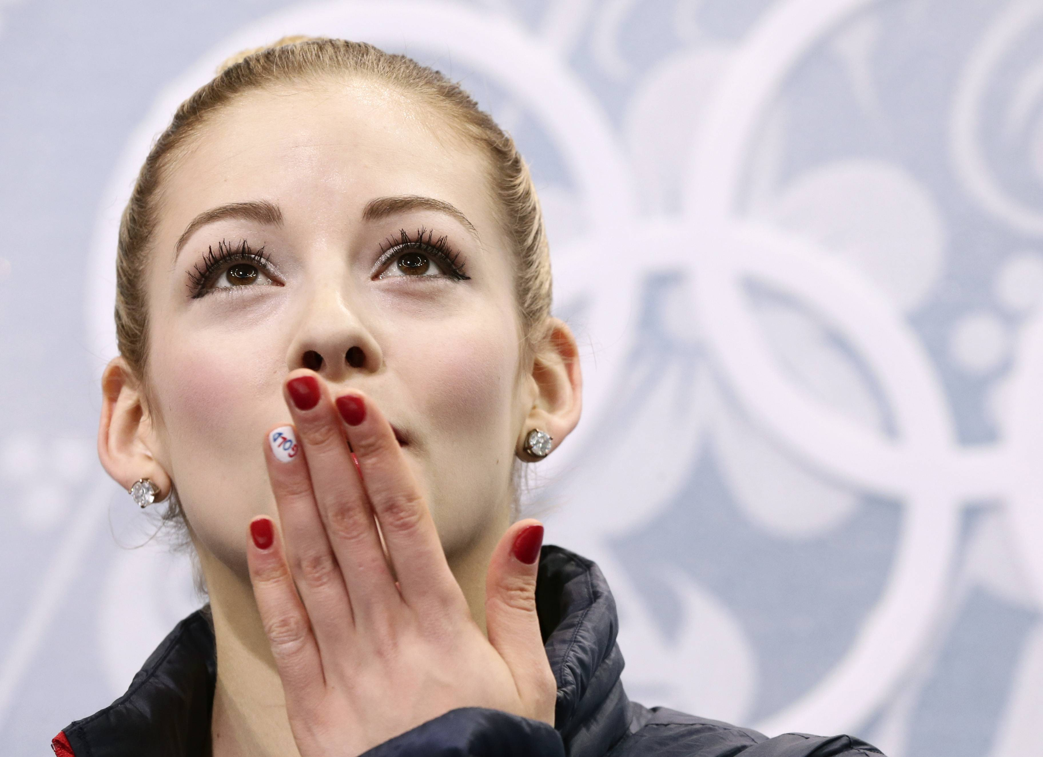 Gracie Gold of the United States blows a kiss to spectators as she waits in the results area after completing her routine in the women's short program figure skating competition at the Iceberg Skating Palace during the 2014 Winter Olympics, Wednesday, Feb. 19, 2014, in Sochi, Russia.