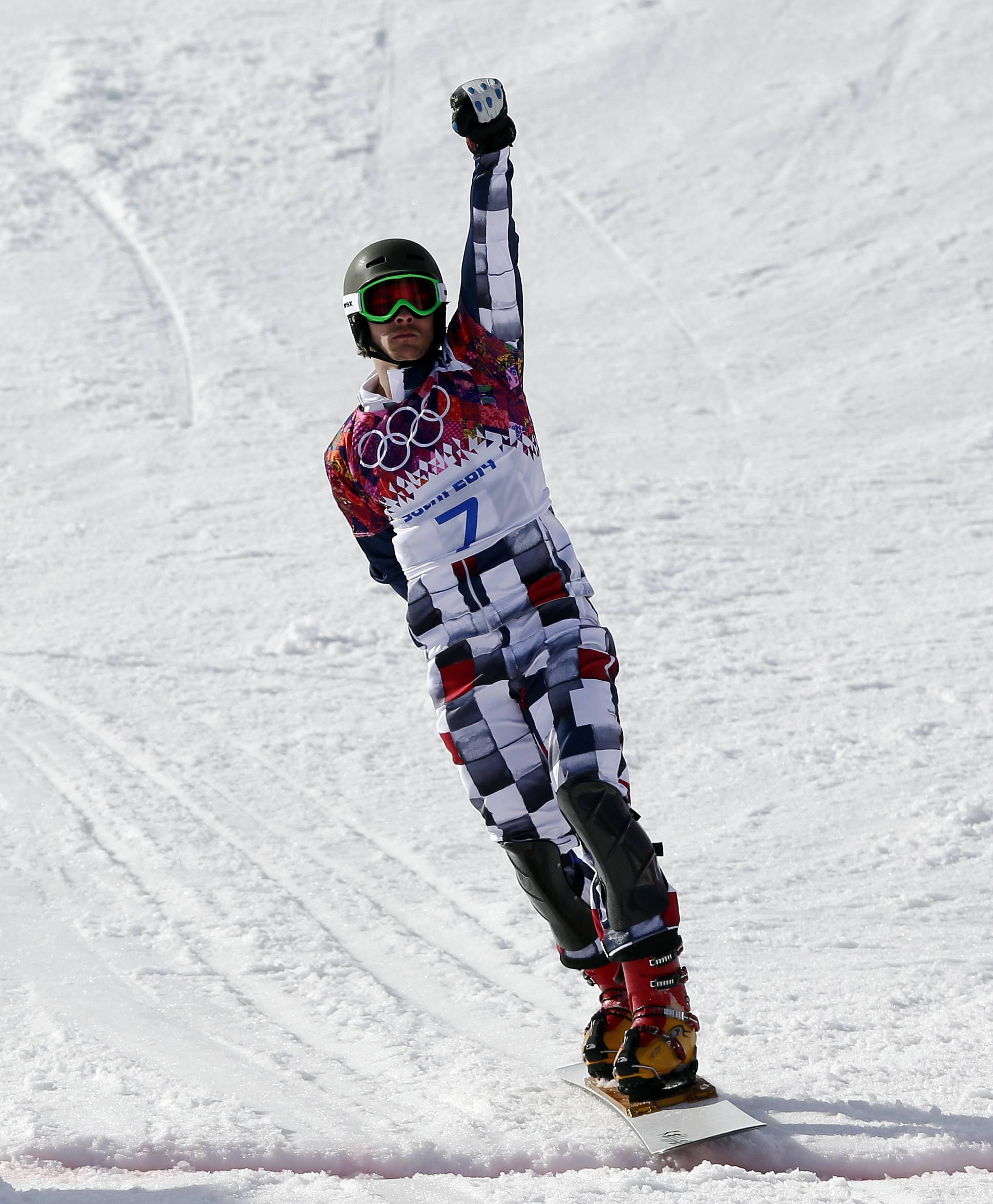 Russia's Vic Wild celebrates Wednesday as he crosses the line to win the gold medal in the men's snowboard parallel giant slalom final at the Rosa Khutor Extreme Park during the 2014 Winter Olympics in Krasnaya Polyana, Russia.