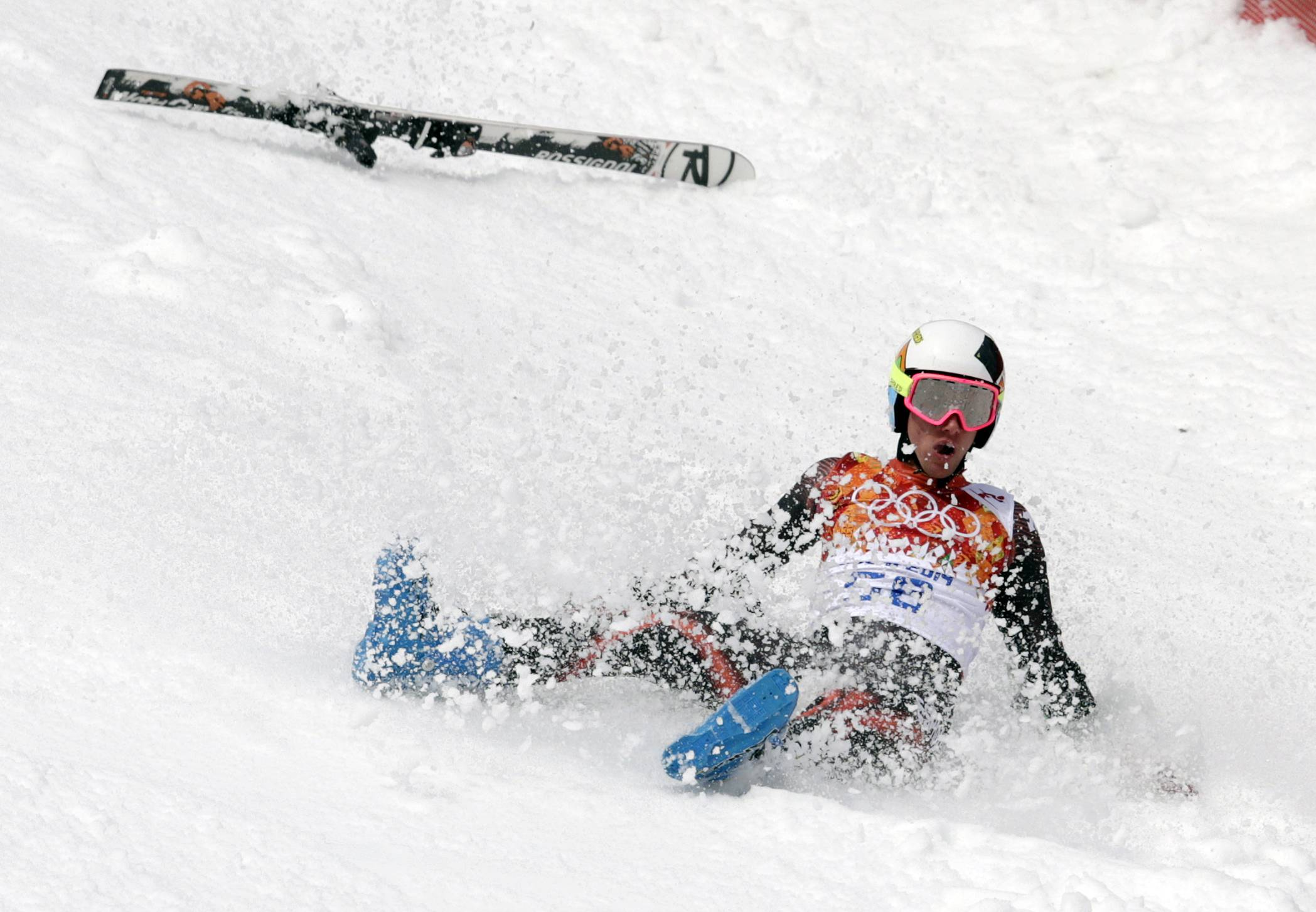 Spain's Alex Puente Tasias slides down the course after crashing Wednesday during the first run of the men's giant slalom at the Sochi 2014 Winter Olympics in Krasnaya Polyana, Russia.