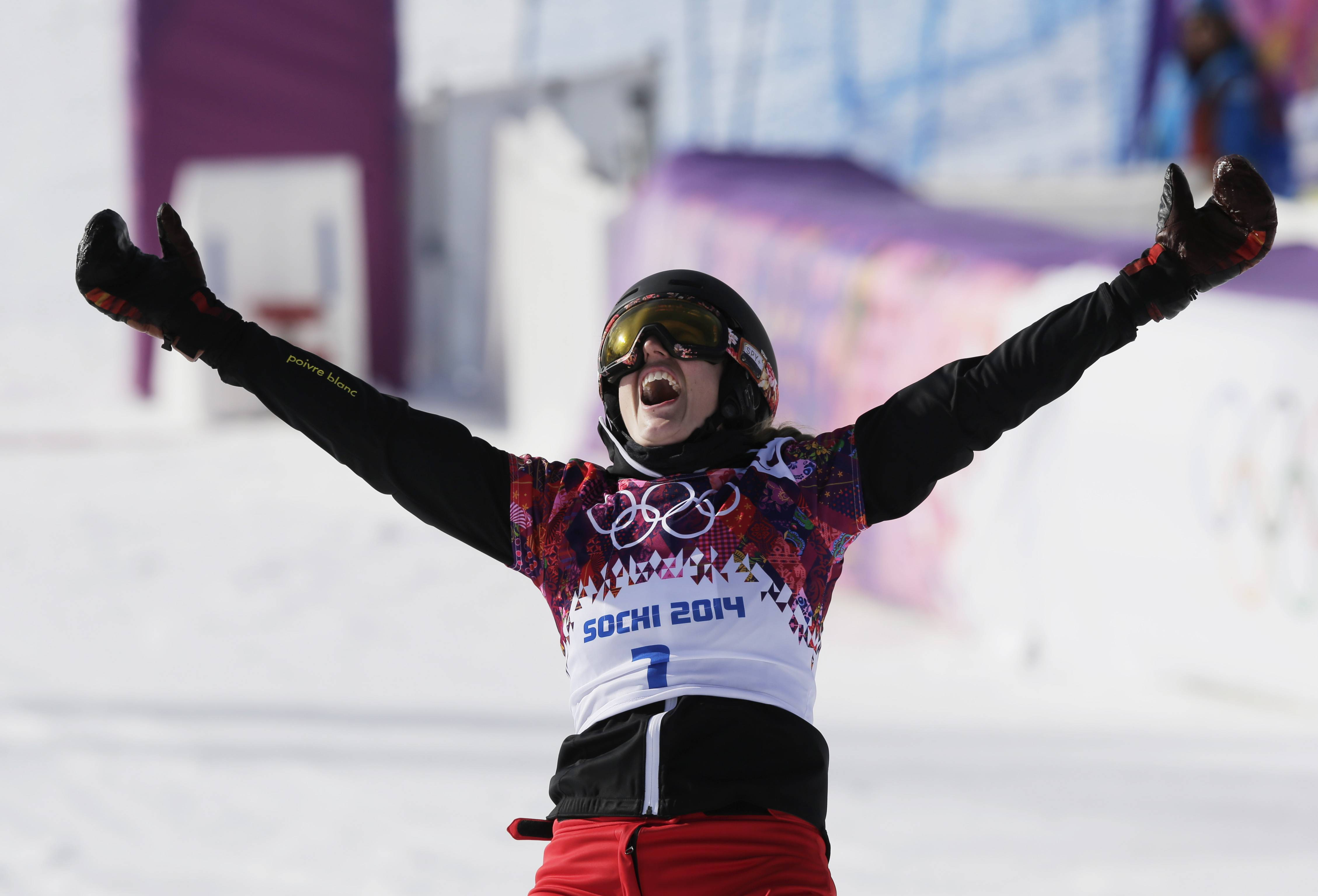 Switzerland's Patrizia Kummer celebrates Wednesday after winning the gold medal in the women's snowboard parallel giant slalom final at the Rosa Khutor Extreme Park during the 2014 Winter Olympics in Krasnaya Polyana, Russia.