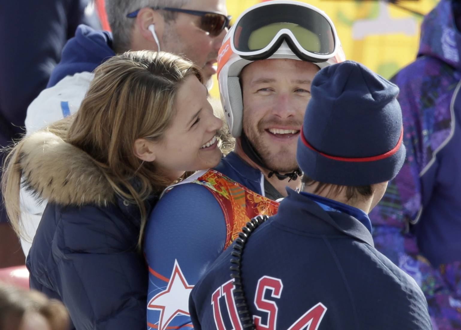 United States' Bode Miller is joined by his wife Morgan after he finished the second run in the men's giant slalom at the Sochi 2014 Winter Olympics, Wednesday, Feb. 19, 2014, in Krasnaya Polyana, Russia.
