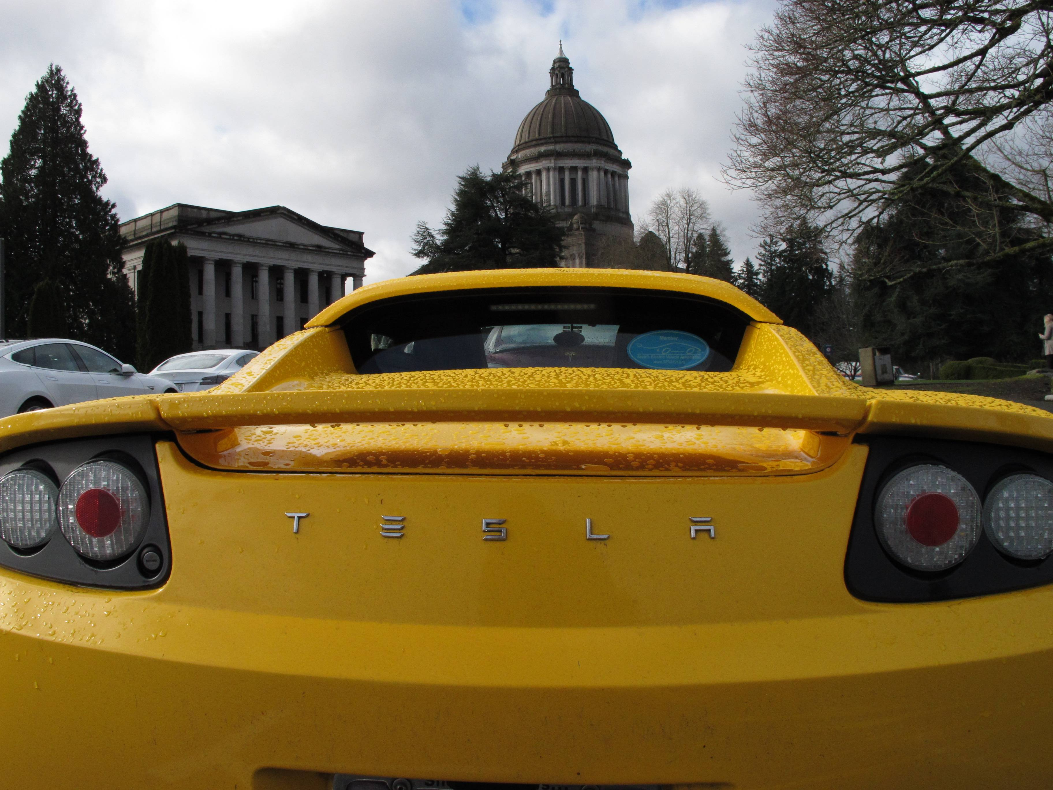 A Tesla car is parked near the Washington state Capitol on Monday, Feb. 17, 2014, in Olympia, Wash.
