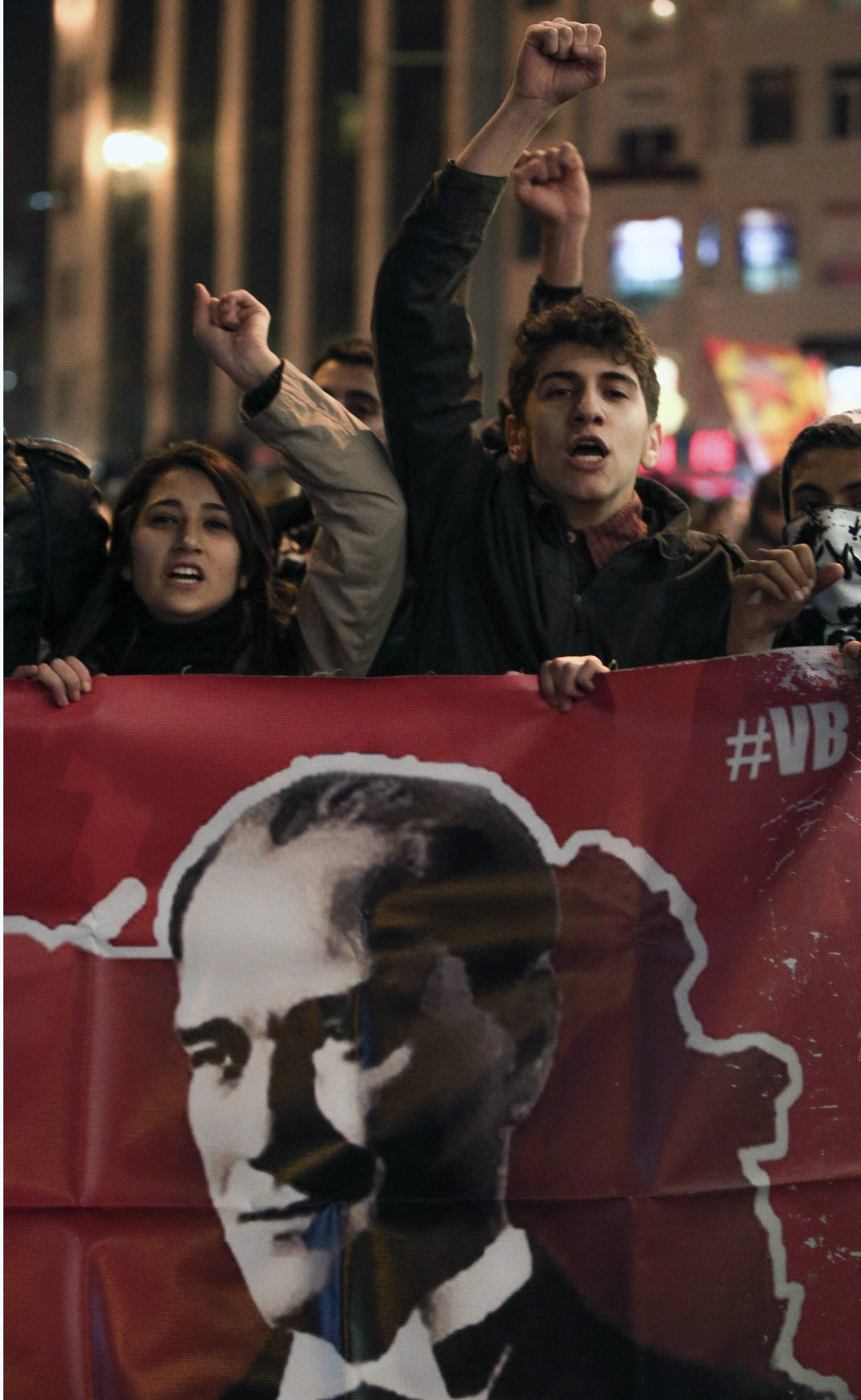 People hold a poster of modern Turkey's founder Kemal Ataturk as they protest against Internet restrictions in Istanbul, Turkey.