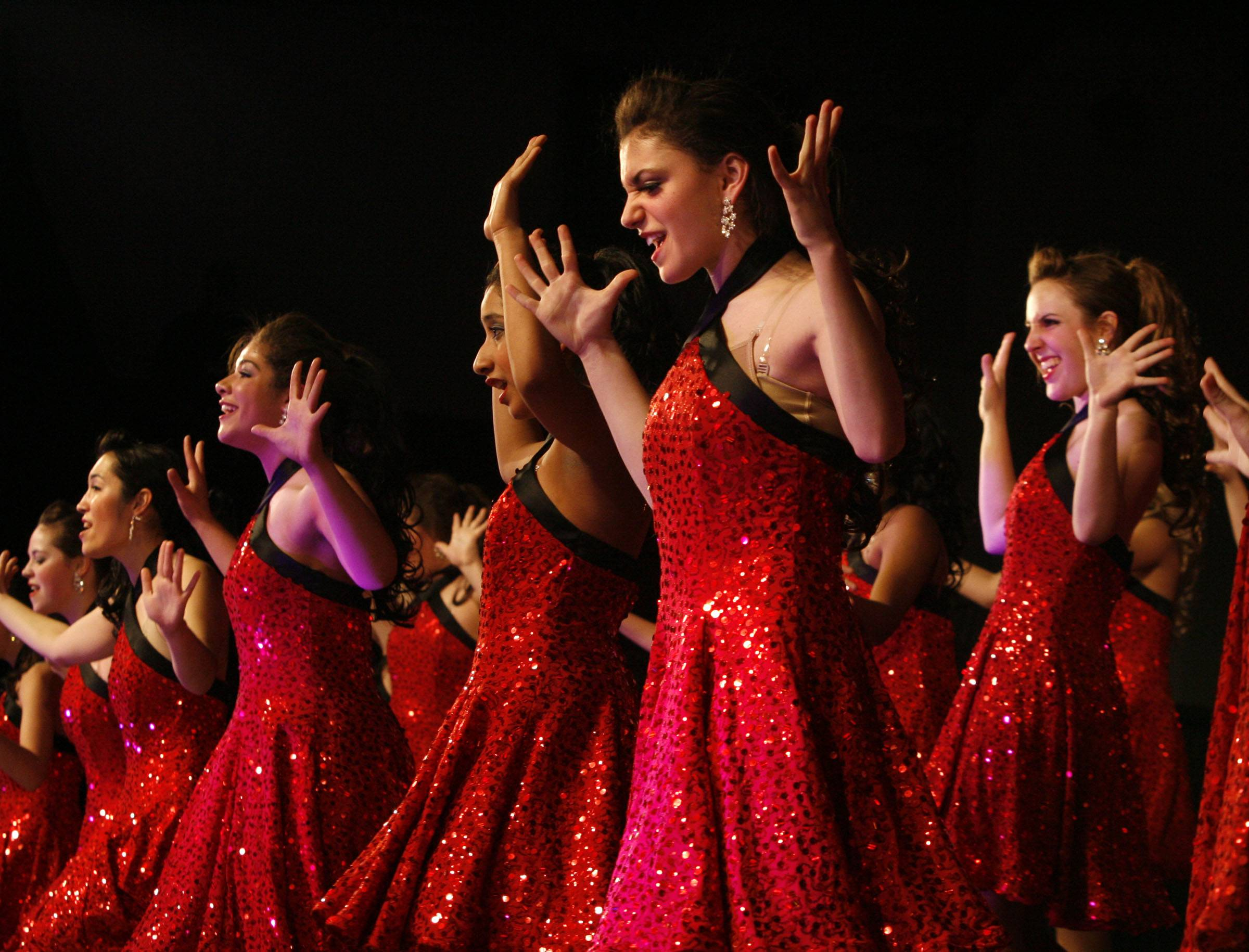 Hersey's Ladies First performs at a past Chicagoland Showcase show choir competition at Hersey High School in Arlington Heights. A suburban Republican lawmaker wants to give show choir participants the chance to opt out of gym class.