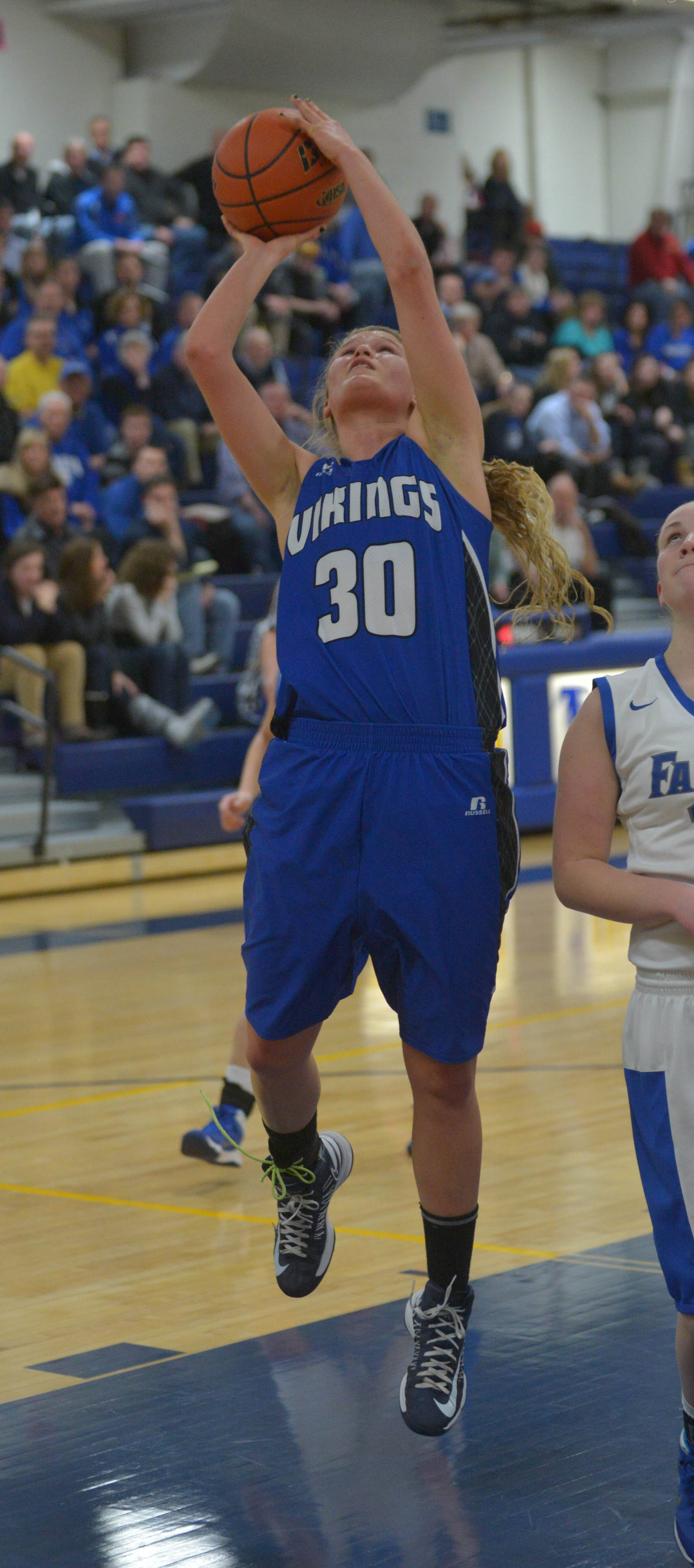Janie McCloughan of Geneva takes a shot during the Geneva at Wheaton North girls basketball regional final Thursday.