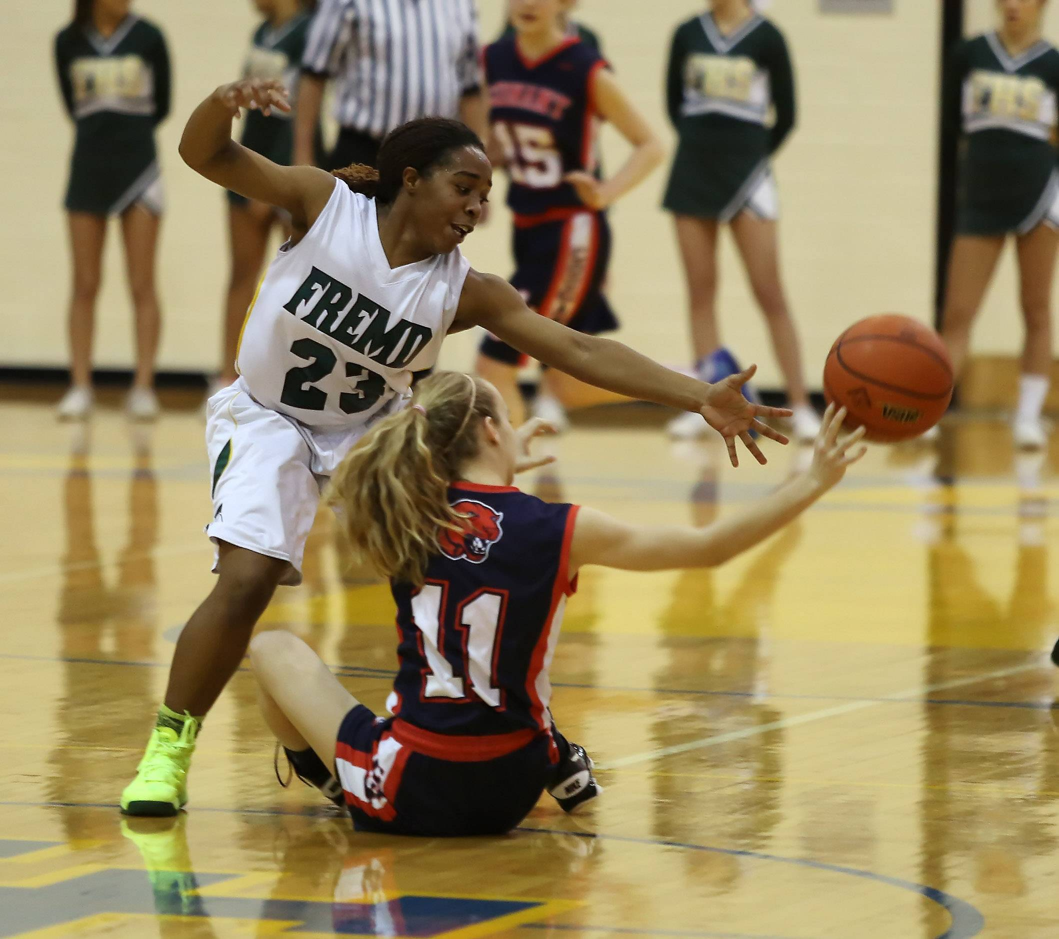 Fremd defender Brianna Lewis tries to stop a pass by Conant guard Danielle Engelbreit during Class 4A regional final action Thursday at Lake Forest.