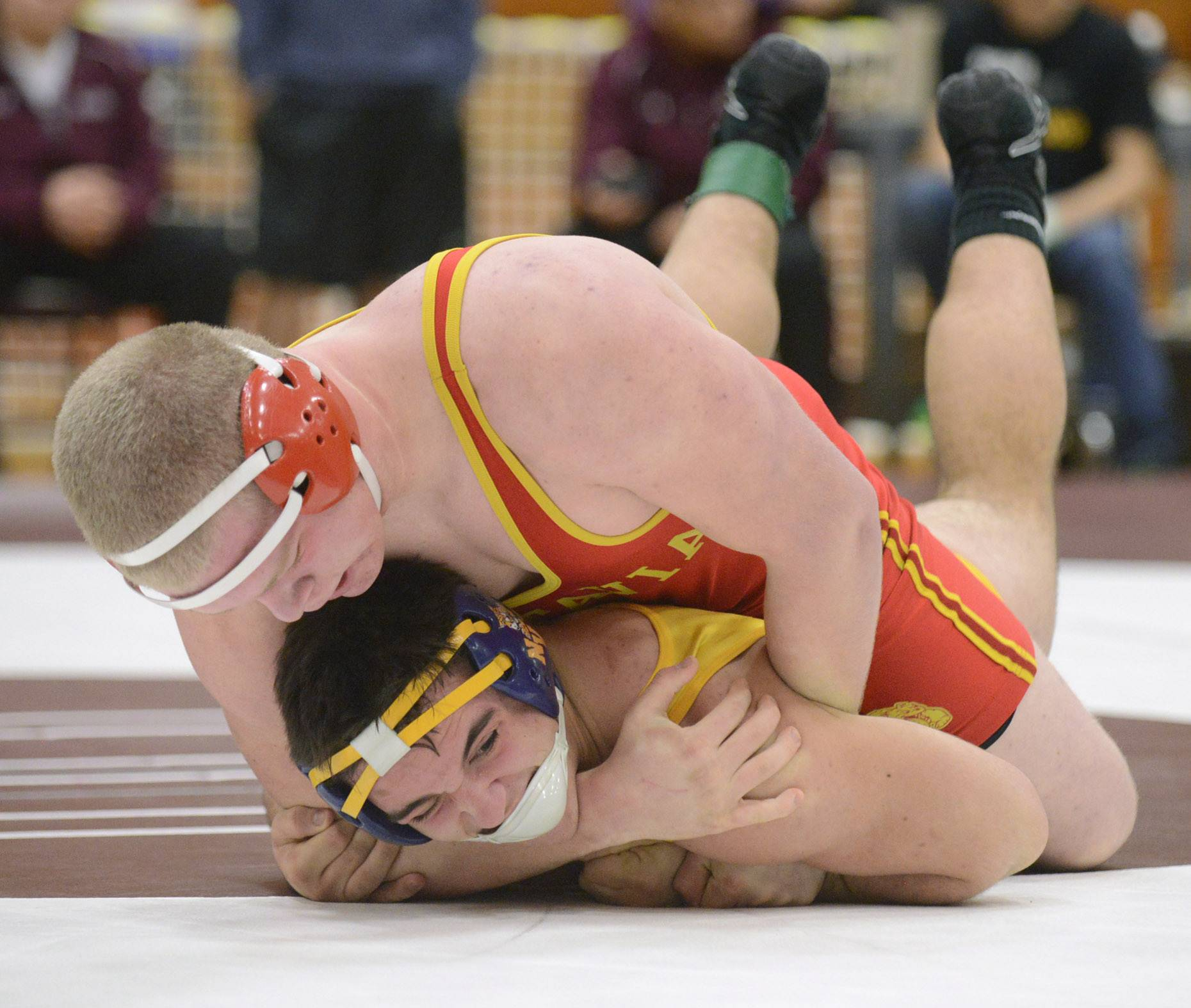 Batavia's Connor McKeehan pins Neuqua Valley's DJ Warkenthien in the 220-pound match final at the Upstate Eight Conference championship at Elgin High School last month.