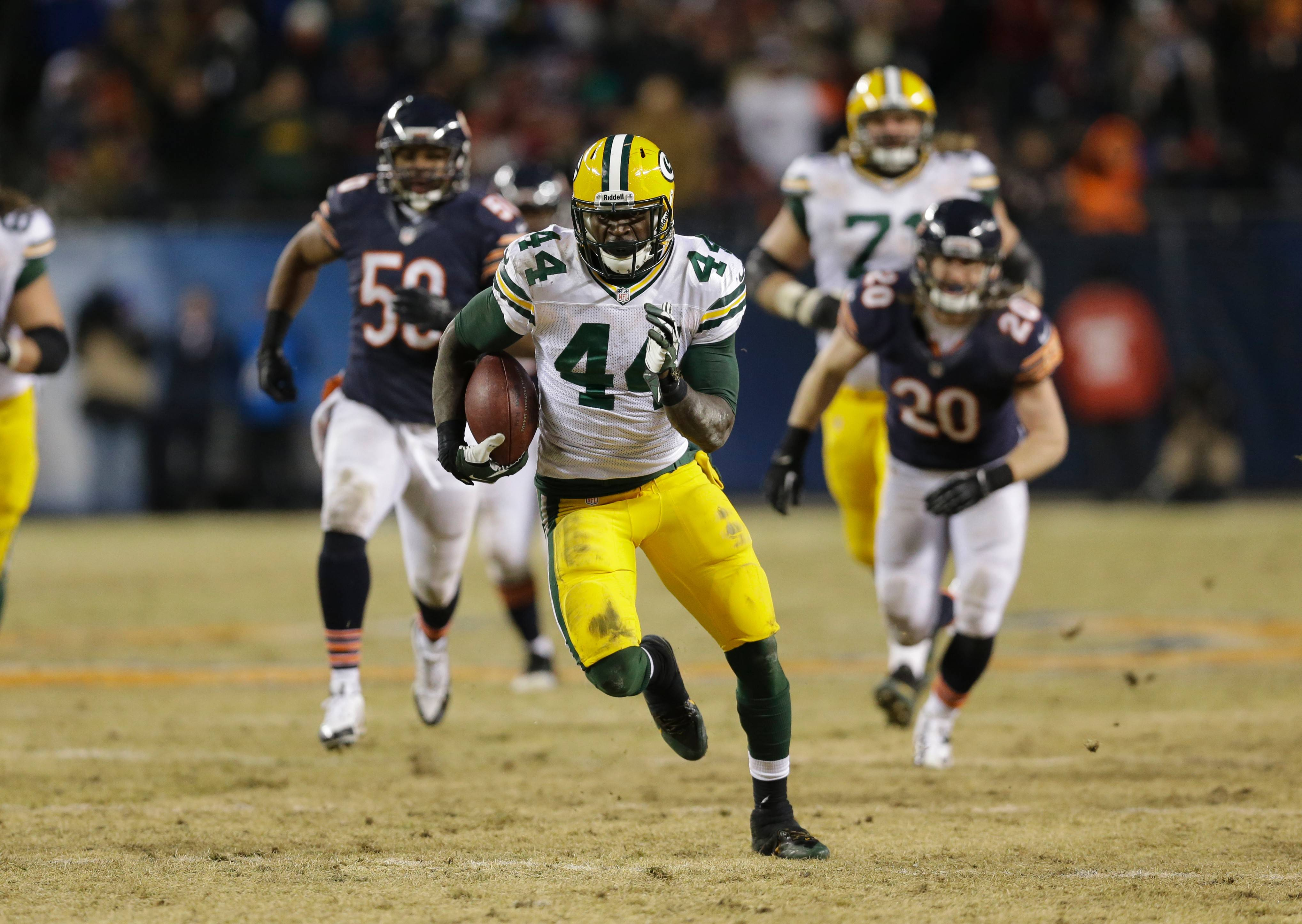 Green Bay Packers running back James Starks (44) runs against Chicago Bears defense during the second half of an NFL football game, Sunday, Dec. 29, 2013, in Chicago. (AP Photo/Nam Y. Huh)