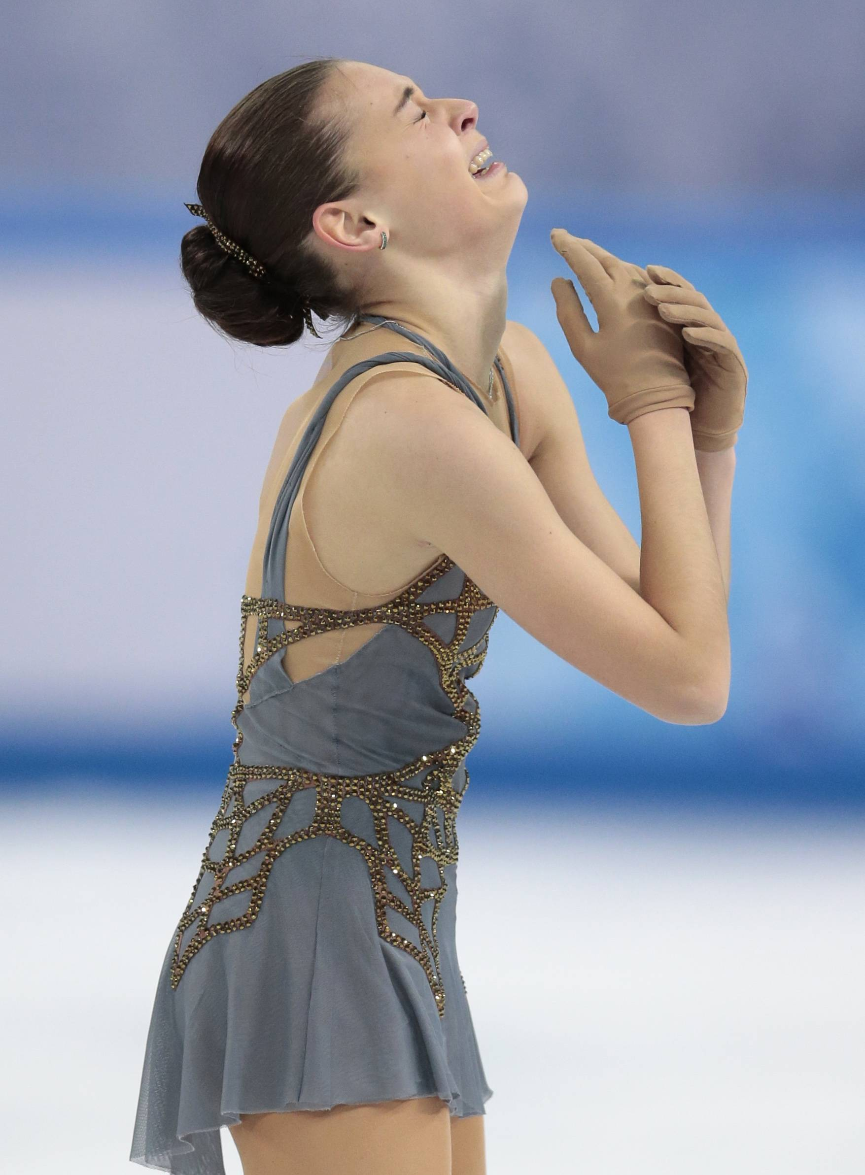 Adelina Sotnikova of Russia reacts Thursday after completing her routine in the women's free skate figure skating finals at the Iceberg Skating Palace during the 2014 Winter Olympics in Sochi, Russia.