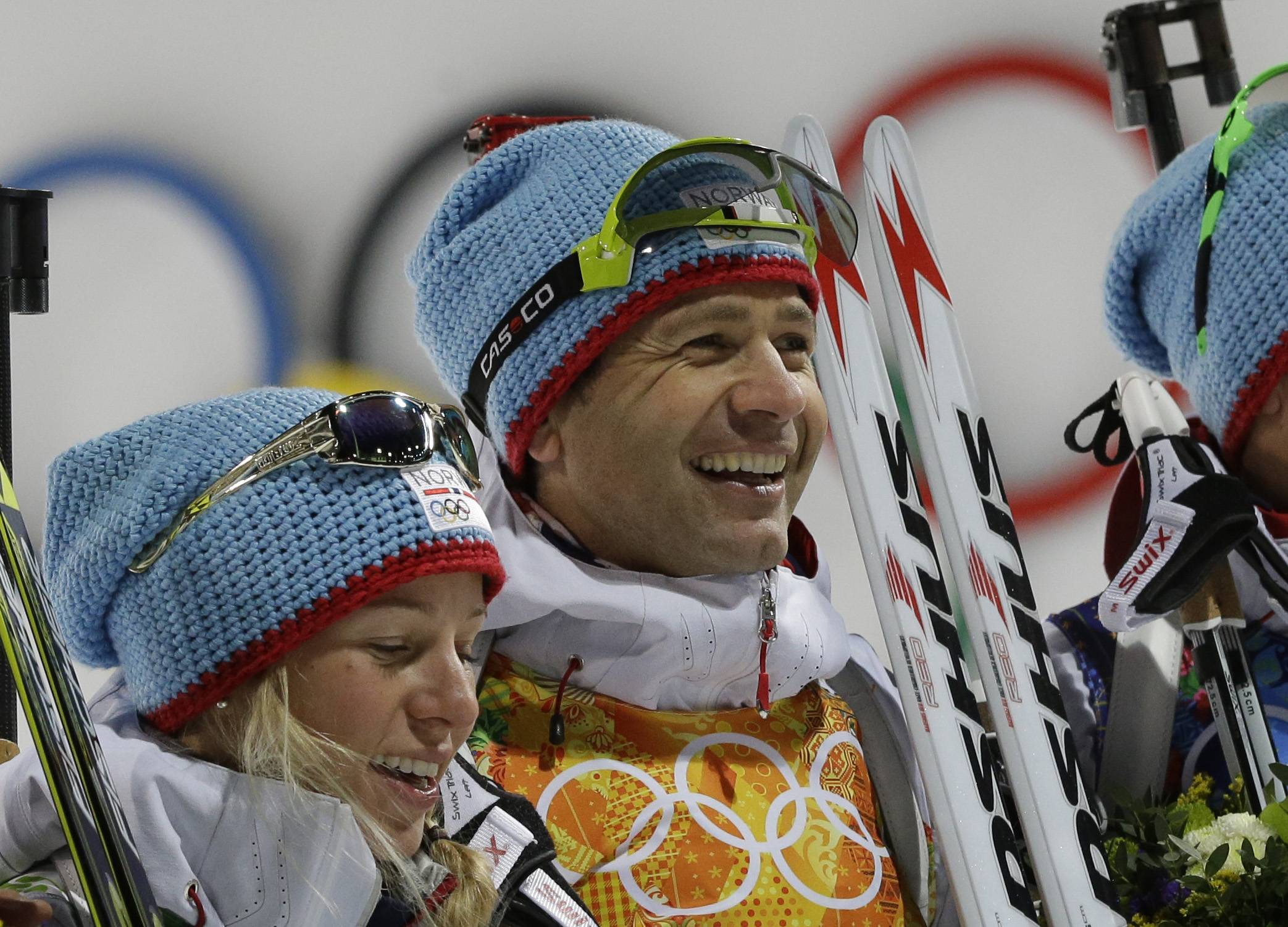 Norway's Ole Einar Bjoerndalen, right, and Tiril Eckhoff smile after winning the gold during the mixed biathlon relay at the 2014 Winter Olympics, Wednesday, Feb. 19, 2014, in Krasnaya Polyana, Russia. The win helped put Norway back atop the medal standings.