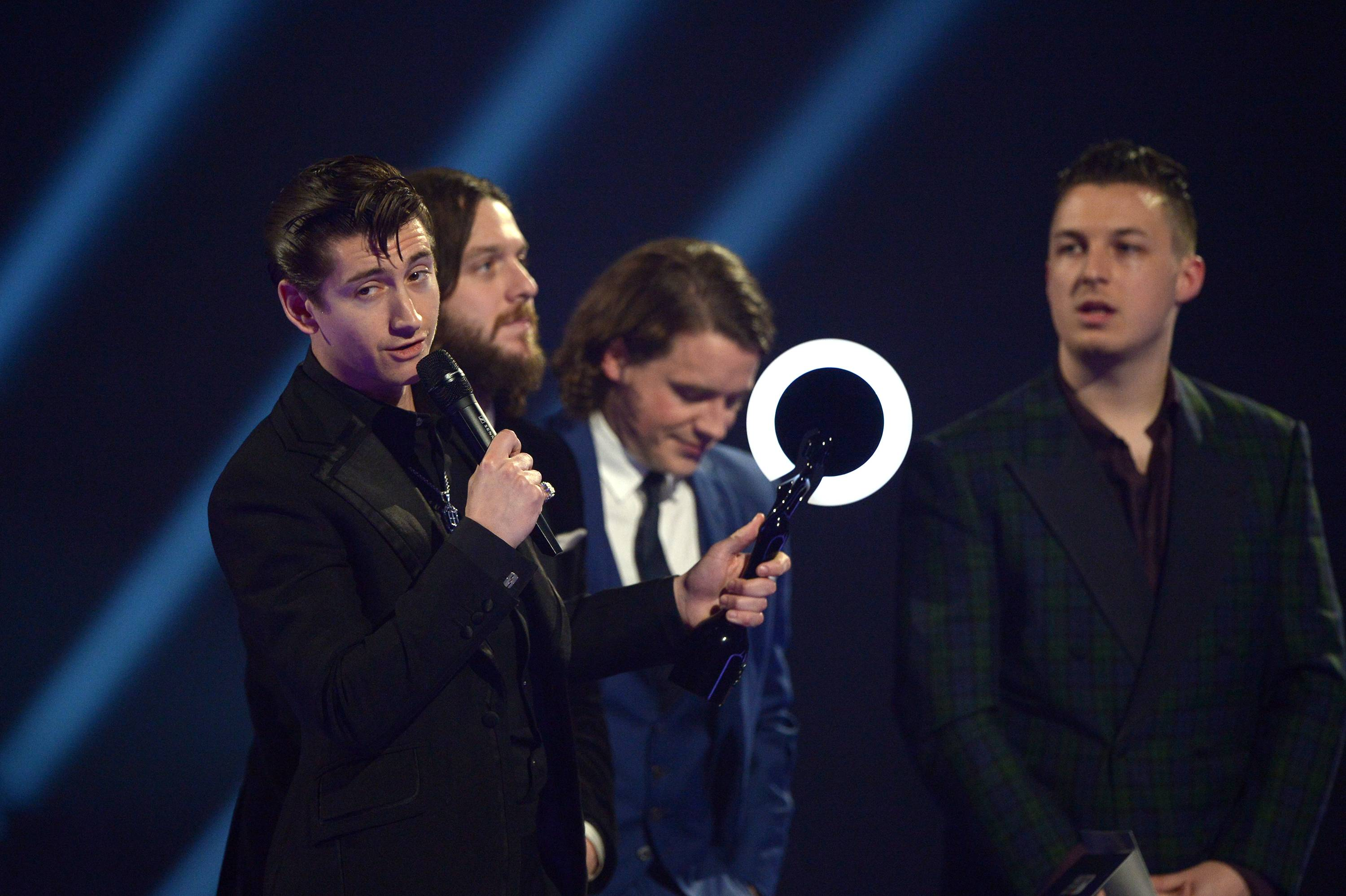 British band Arctic Monkeys accept the Best Album of the Year award onstage at the BRIT Awards 2014 at the O2 Arena in London on Wednesday.