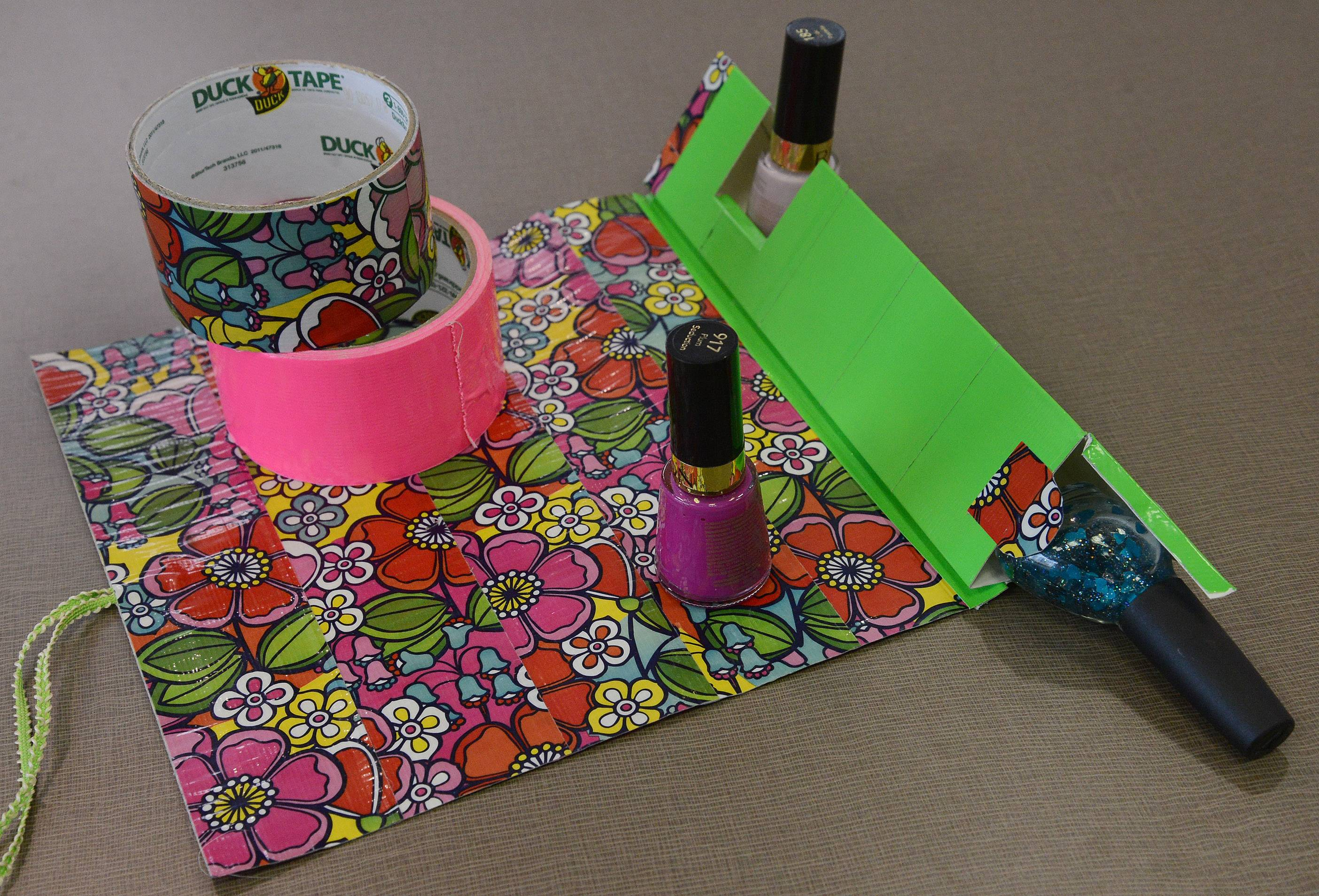 Duct tape gets put to good use in the creation of a nail polish mat in one of Dawn Pennacchia's library workshops.