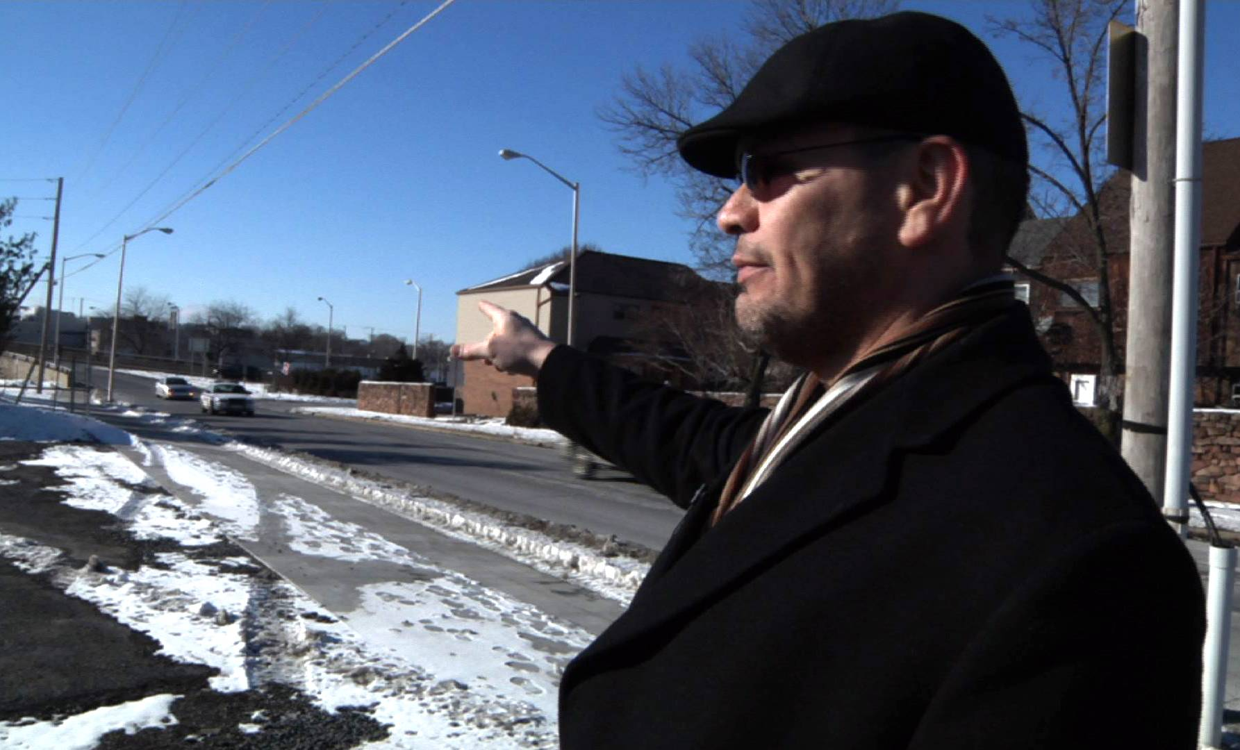 Ricardo Nieves stands in a parking lot where he says his rights were violated when a government contractor questioned him about his driving habits and asked him to provide a saliva sample.