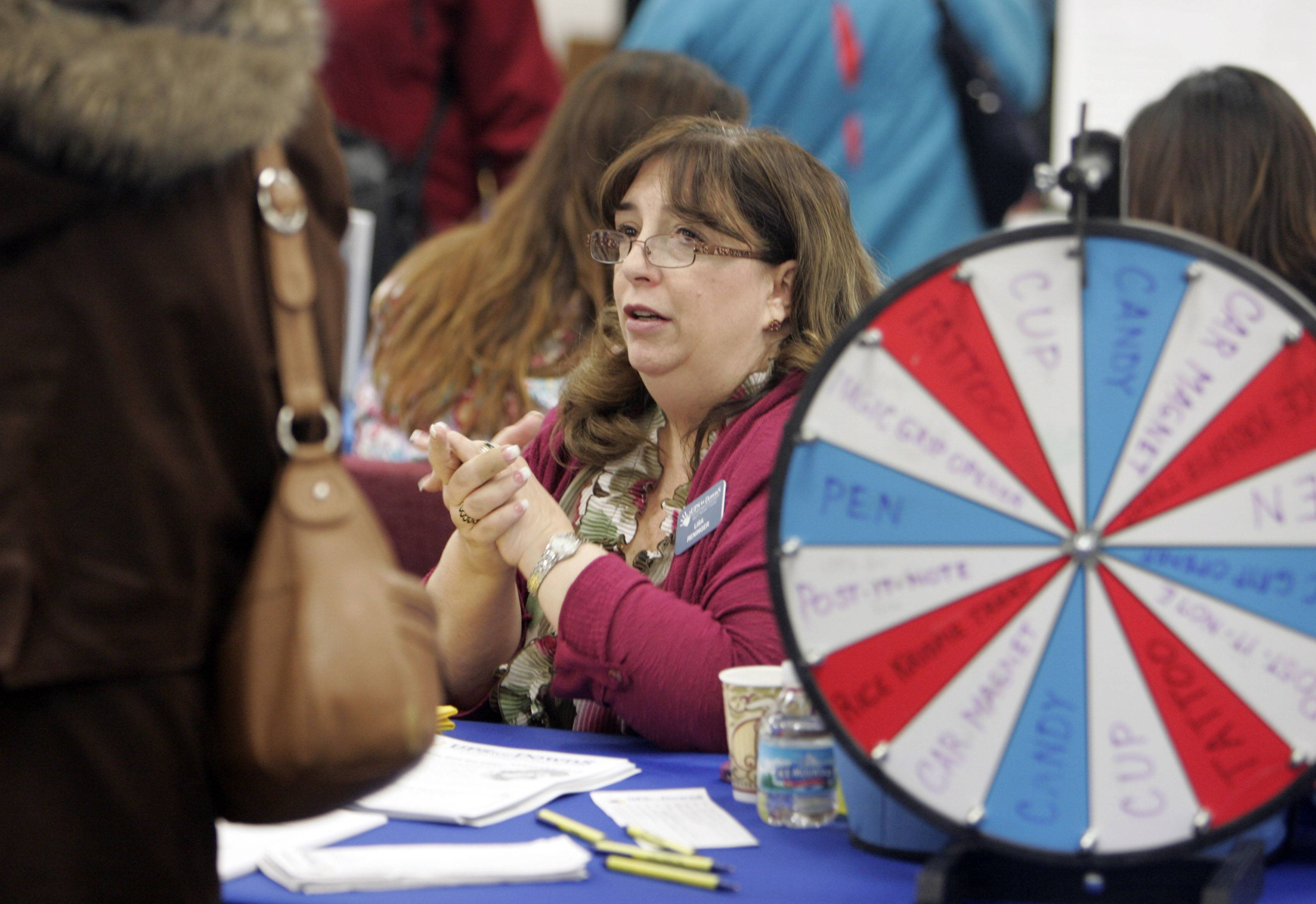 United Parent Support for Down syndrome volunteer Lisa Reninger talks to a woman during the Citizens' Advisory Council and Elgin Area School District U-46's third annual Special Needs Resource Fair last year at Elgin High School.
