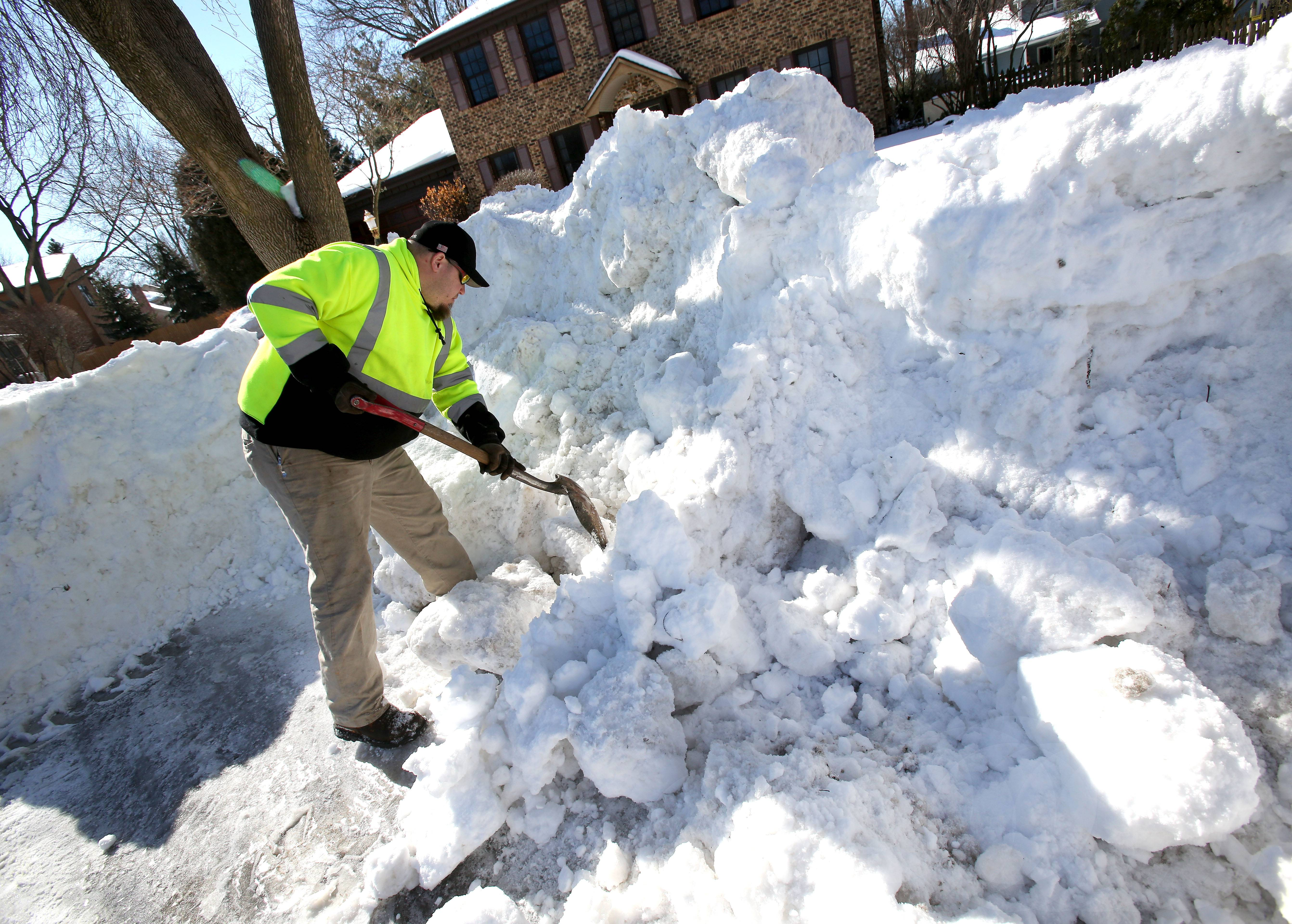 Concerns with possible flooding this week have municipal crews -- and many residents -- clearing ice and snow from storm drains. Nate Langston with Naperville's public works department was working Wednesday along Palm Court.