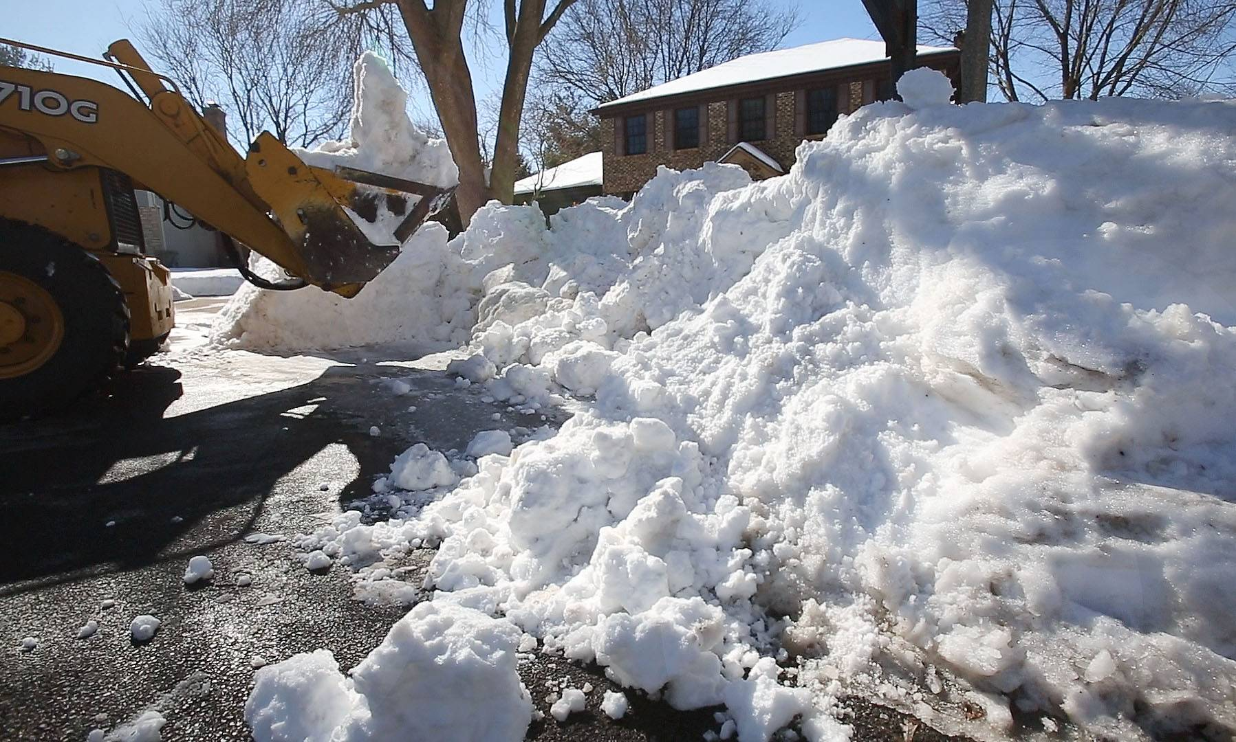 Naperville public works crews had to use a bulldozer to help clear storm drains in some portions of the city.
