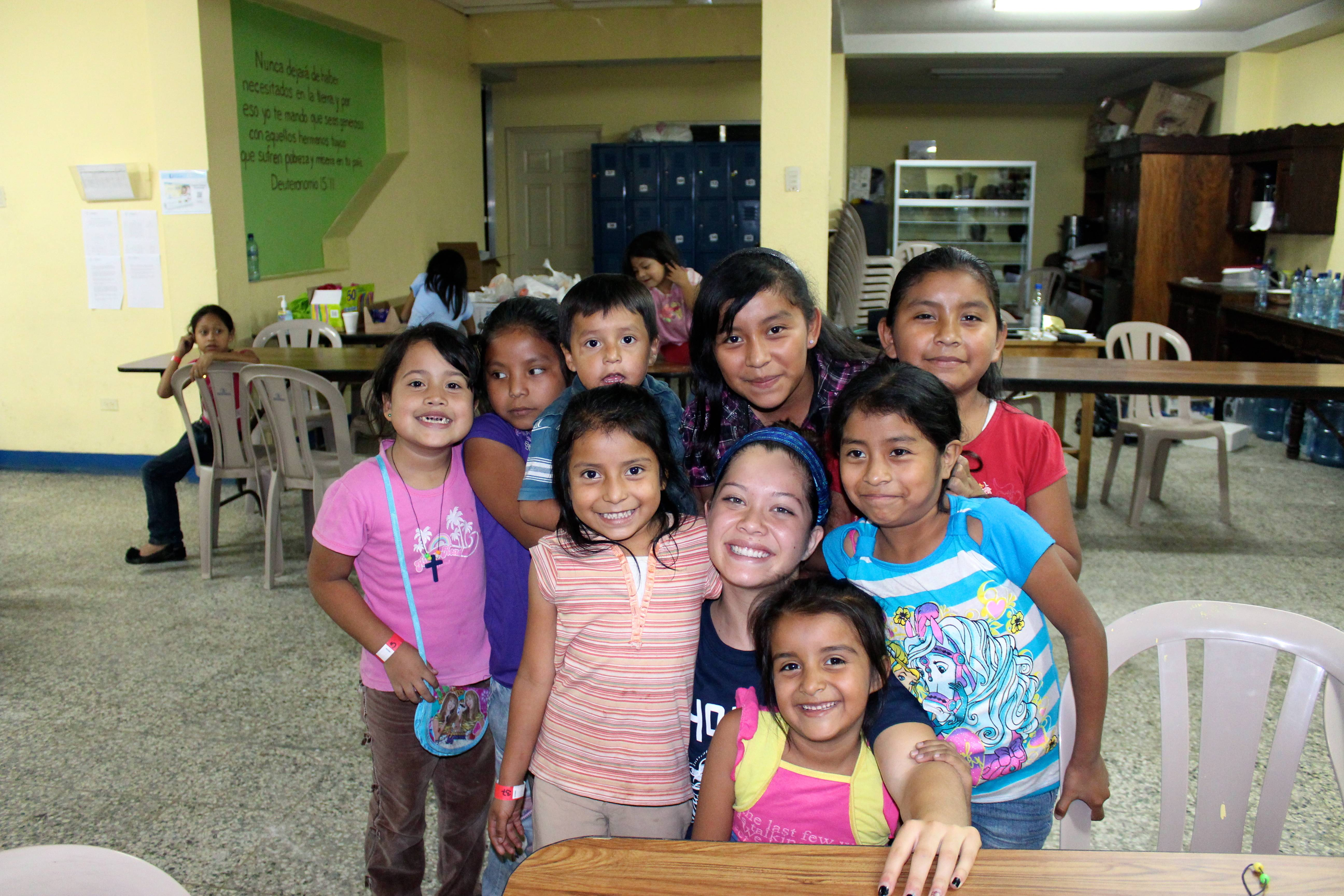 Twin sisters Courtney, center in blue headband, and Ashley Quigley traveled to Guatemala last year to help build a home for a needy family. The 17-year-old Barrington High School seniors are the organizers of a fashion show in Barrington that benefits families and children in Guatemala.