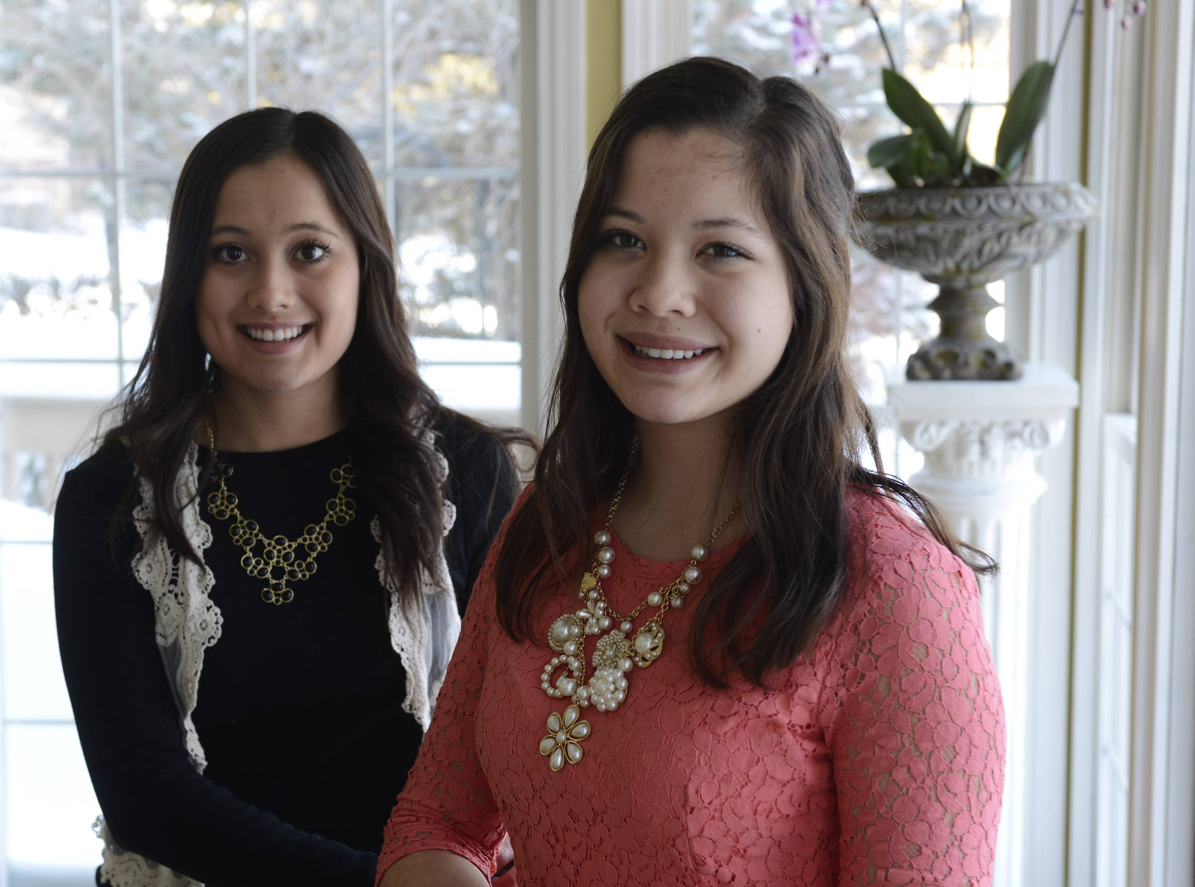 "JOE LEWNARD/jlewnard@dailyherald.com  Courtney Quigley, 17, of Barrington, right, and her twin sister, Ashley, have helped raise money to build homes for desperately poor families in Guatemala through a fashion show called ""Hope's in Style."" This year's show takes place March 1."