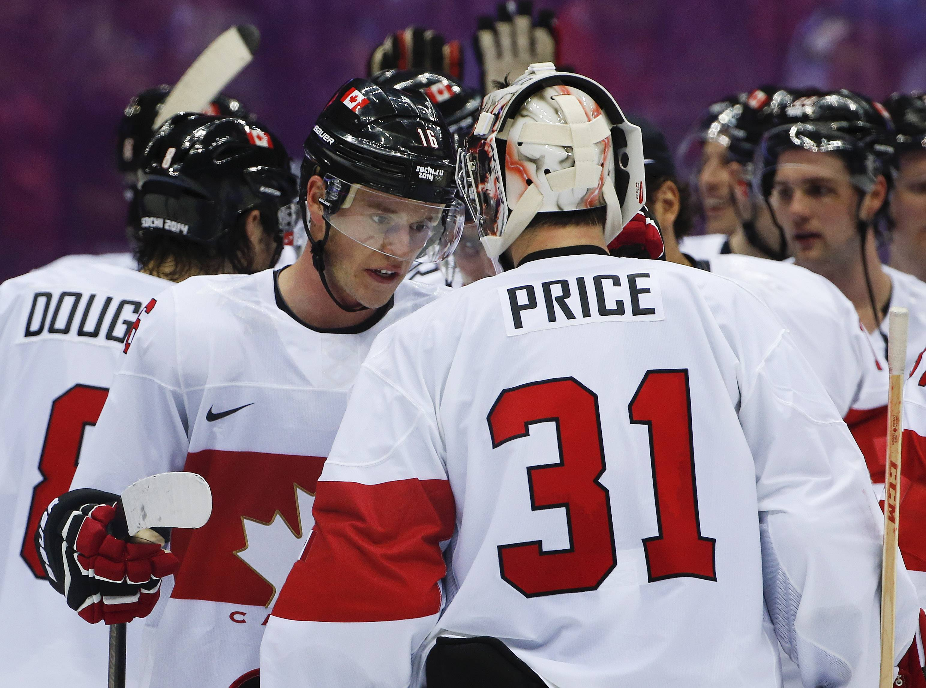 Canada forward Jonathan Toews congratulates Canada goaltender Carey Price after Canada's 2-1 win over Latvia during a men's quarterfinal ice hockey game at the 2014 Winter Olympics, Wednesday, Feb. 19, 2014, in Sochi, Russia.