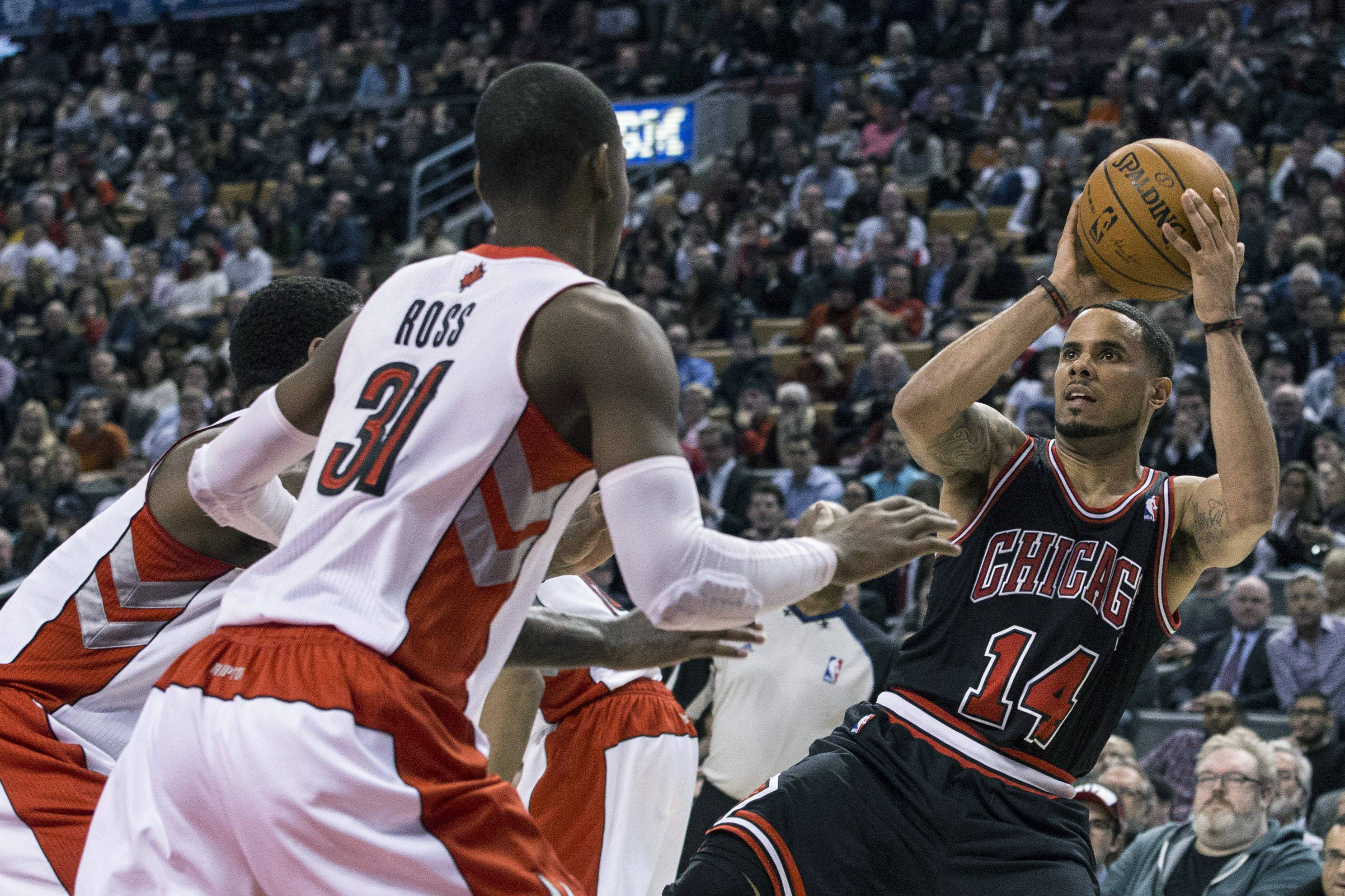 Chicago Bulls' D.J. Augustin (14) scores against Toronto Raptors during the second half of Wednesday's game Toronto. Augstin had 13 points in the fourth quarter to spark the Bulls.