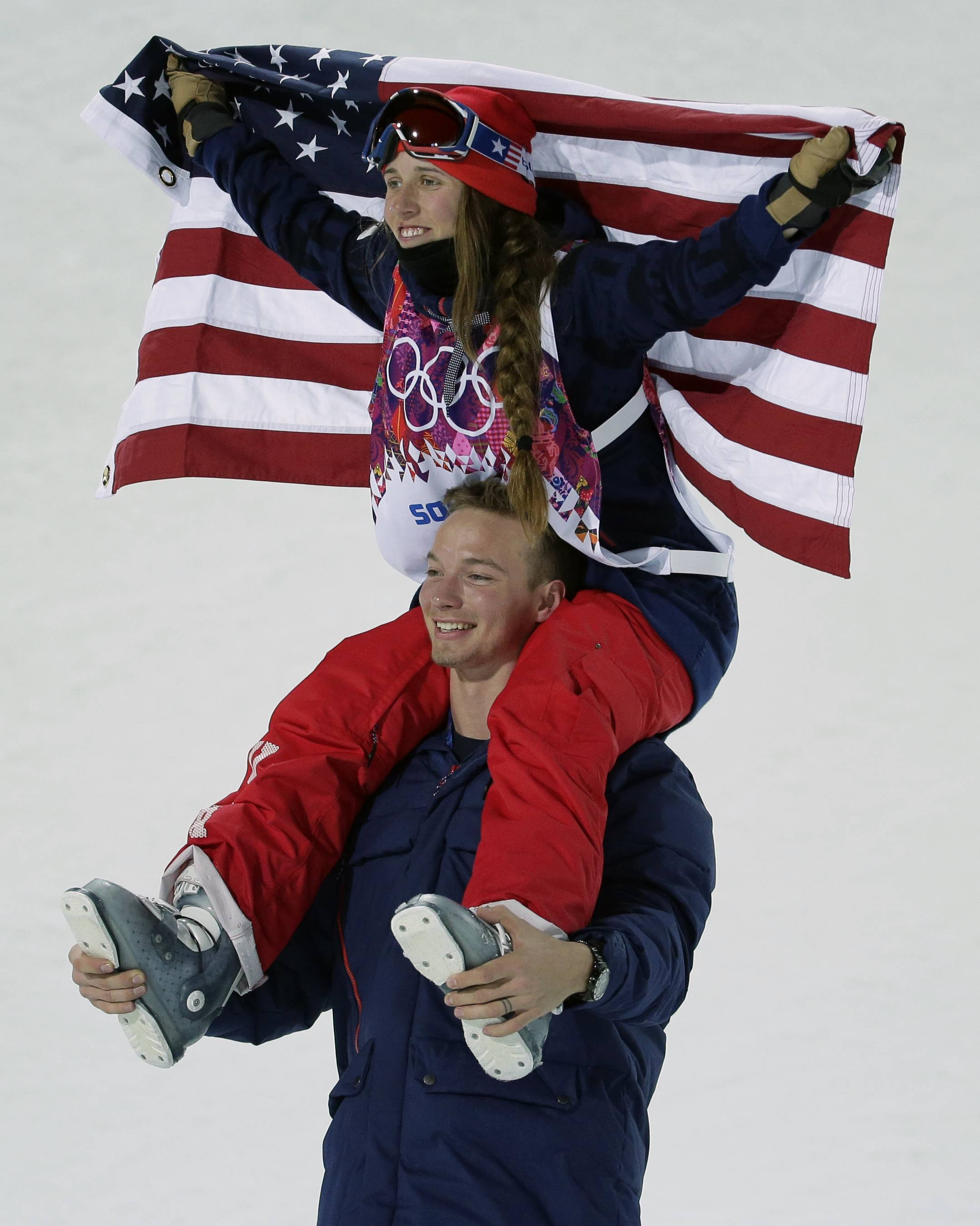 Maddie Bowman of the United States celebrates her gold medal in the women's ski halfpipe final, on the shoulders of David Wise, the men's half pipe gold medal winner.