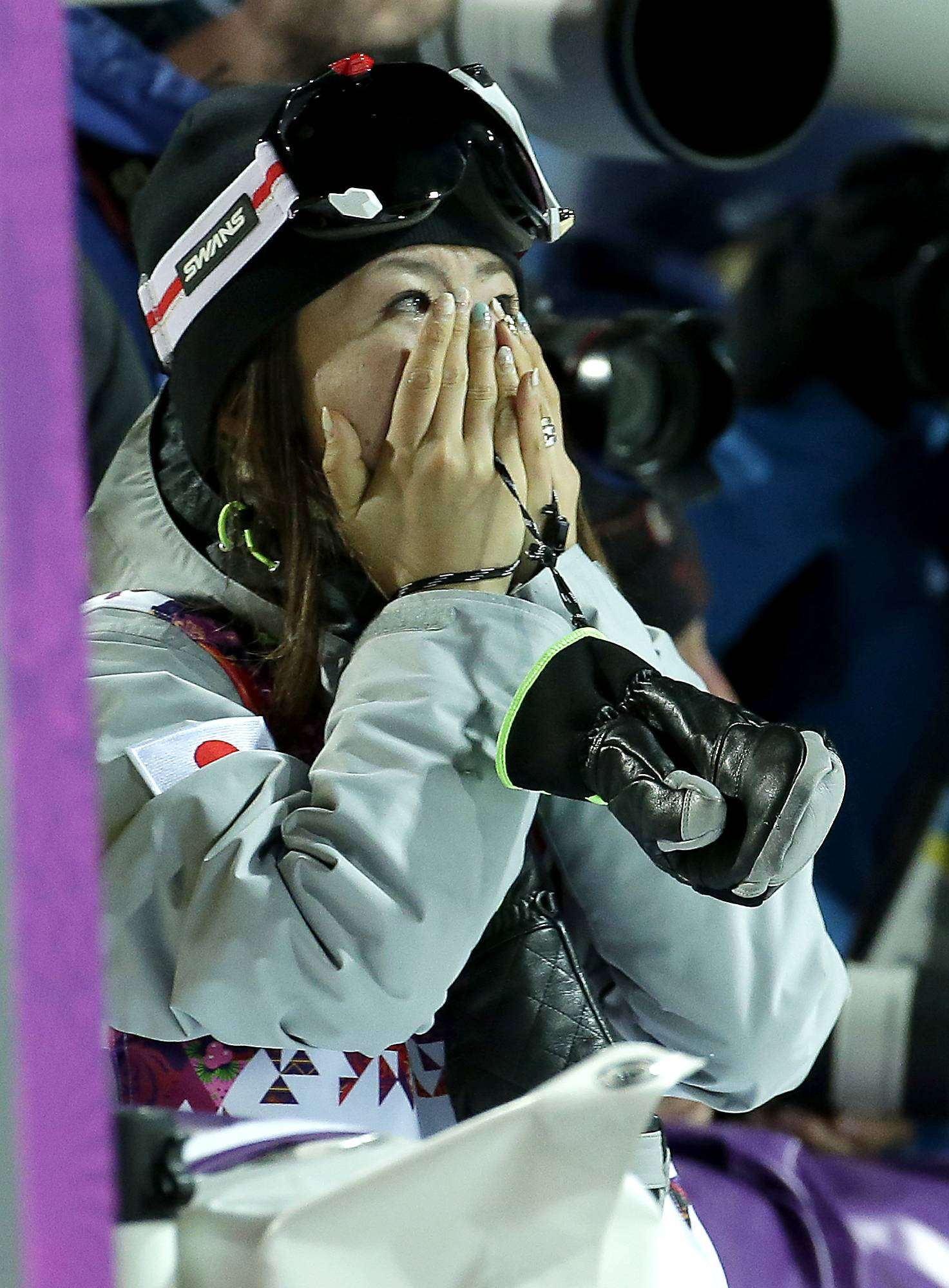 Bronze medalist Japan's Ayana Onozuka reacts after finding out she was among the top three finishers in the women's ski halfpipe competition.
