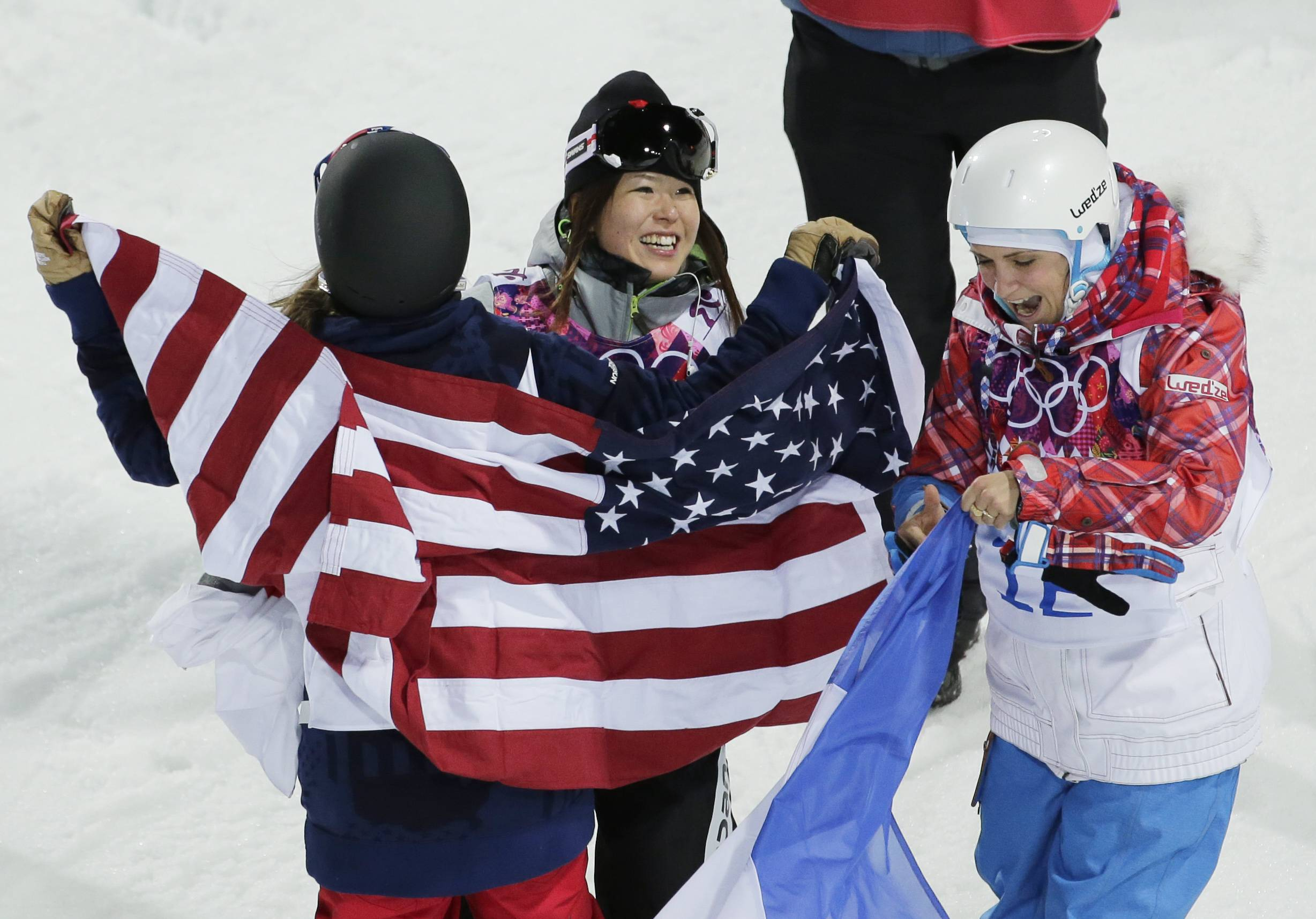 Japan's Ayana Onozuka center, celebrates her bronze medal with gold medalist Maddie Bowman of the United States, left, and silver medalist France's Marie Martinod after the women's ski halfpipe final.