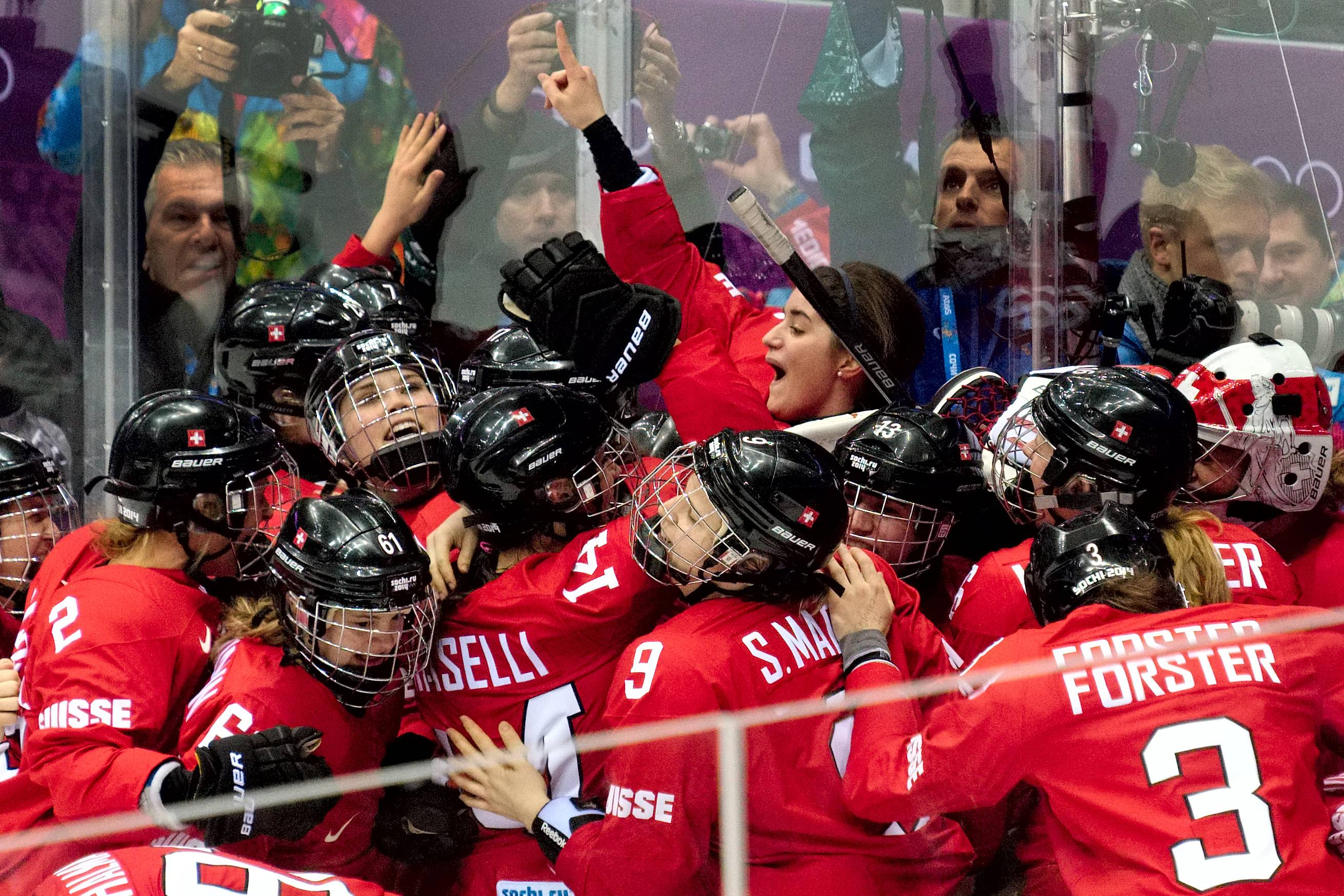 Team Switzerland celebrates their 4-3 win over Sweden in the women's ice hockey bronze medal game at Bolshoy Arena at the 2014 Winter Olympics, Thursday, Feb. 20, 2014, in Sochi, Russia.
