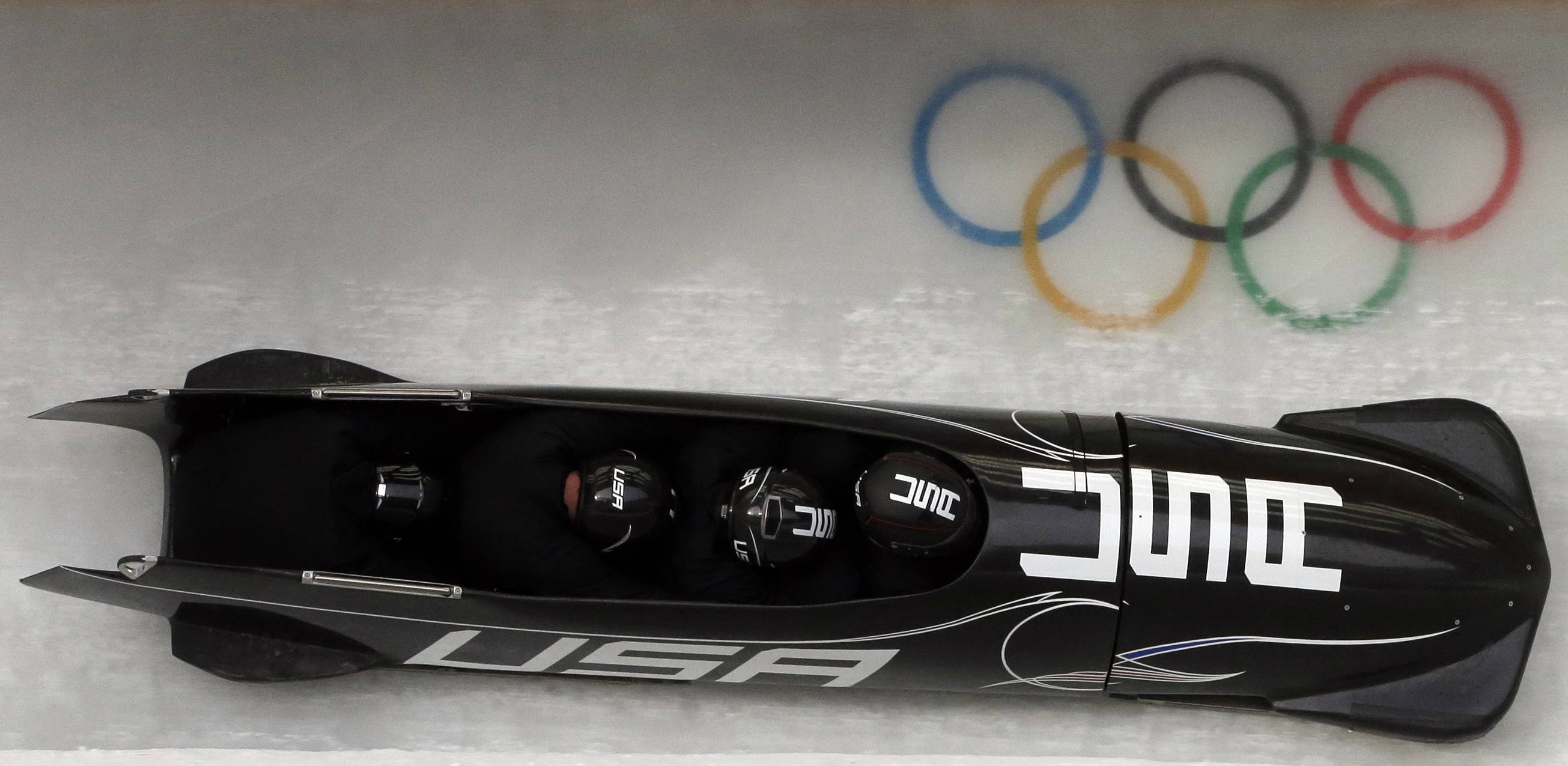 The team from the United States USA-1, piloted by Steven Holcomb, take a curve Thursday during the men's four-man bobsled training at the 2014 Winter Olympics in Krasnaya Polyana, Russia.