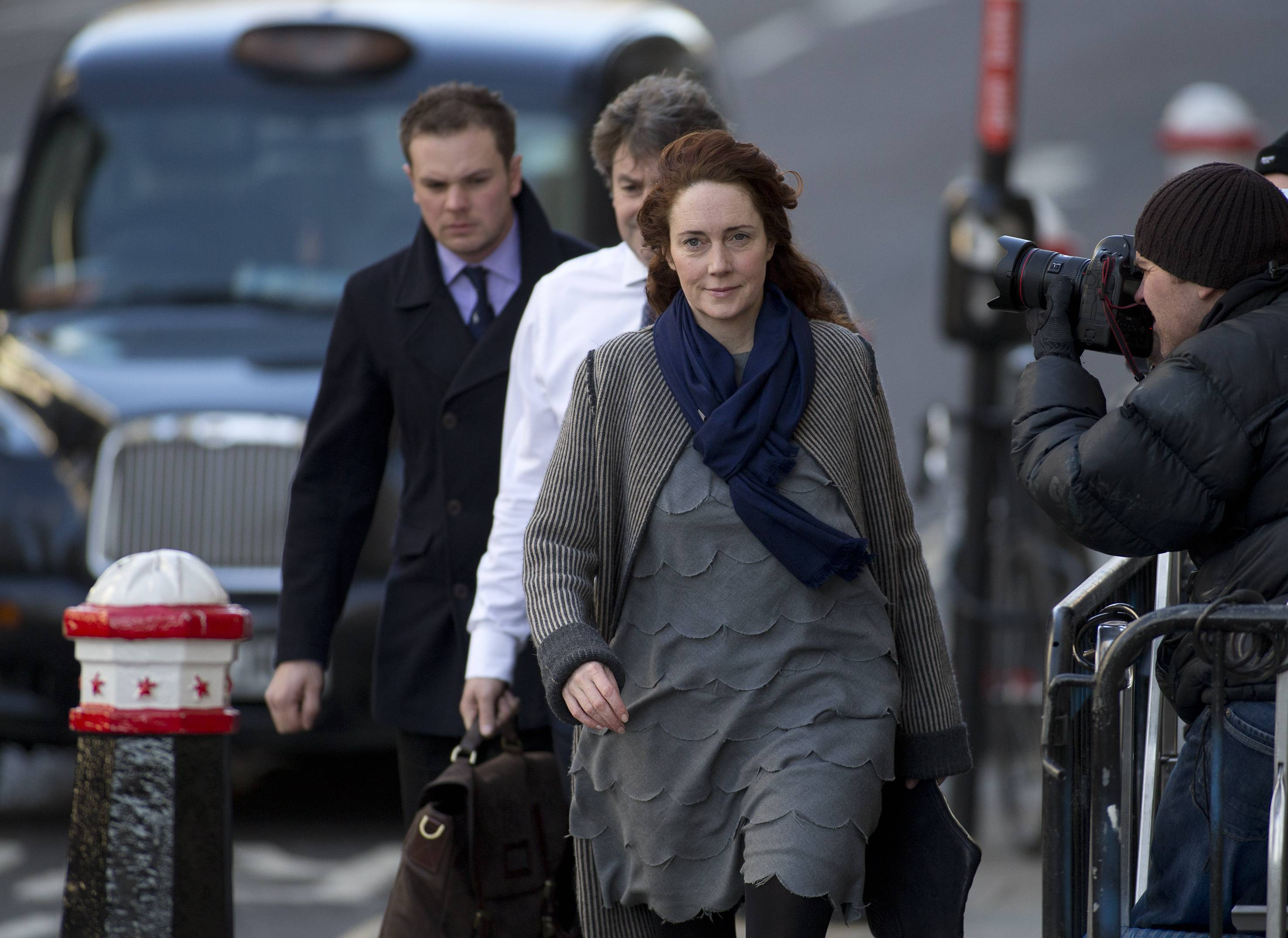 Rebekah Brooks former News International chief executive and her husband Charlie Brooks, centre rear, arrive at the Central Criminal Court in London where they appear to face charges related to phone hacking, Friday.