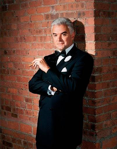 "John O'Hurley returns to play the slick lawyer Billy Flynn in Broadway in Chicago's production of the hit musical ""Chicago."""