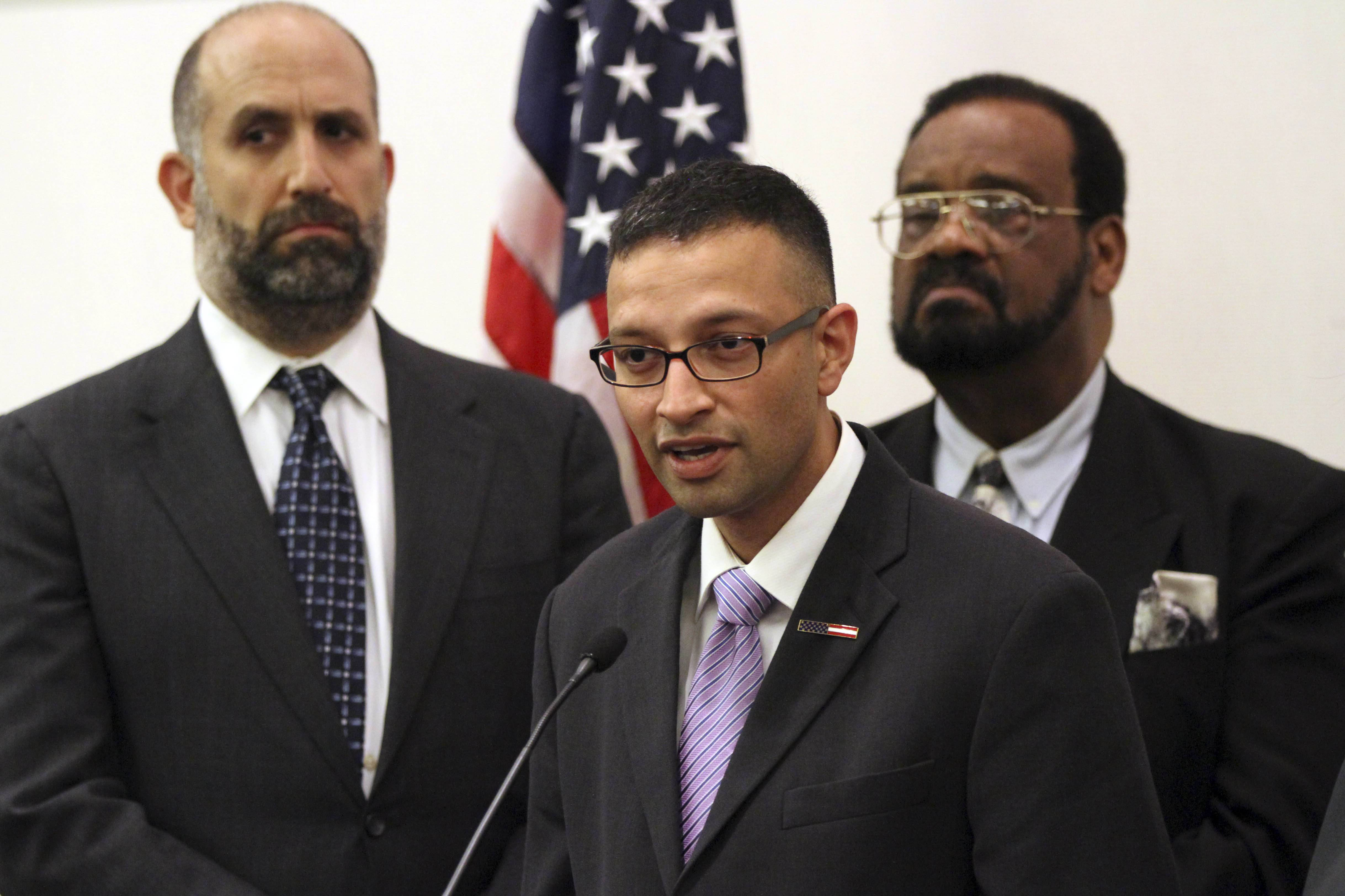 Syed Farhaj Hassan, center, is joined by Glenn Katon, left, legal director of Muslim Advocates, and Imam Abdul Kareem Muhammad. Hassan and Muhammad are two of eight Muslims who filed a federal lawsuit in New Jersey on grounds that the New York Police Department's surveillance programs on New Jersey Muslims was unconstitutional, because it focused on religion, national origin and race. A federal judge on Thursday, Feb. 20, 2014 struck down Hassan and Muhammad's lawsuit.
