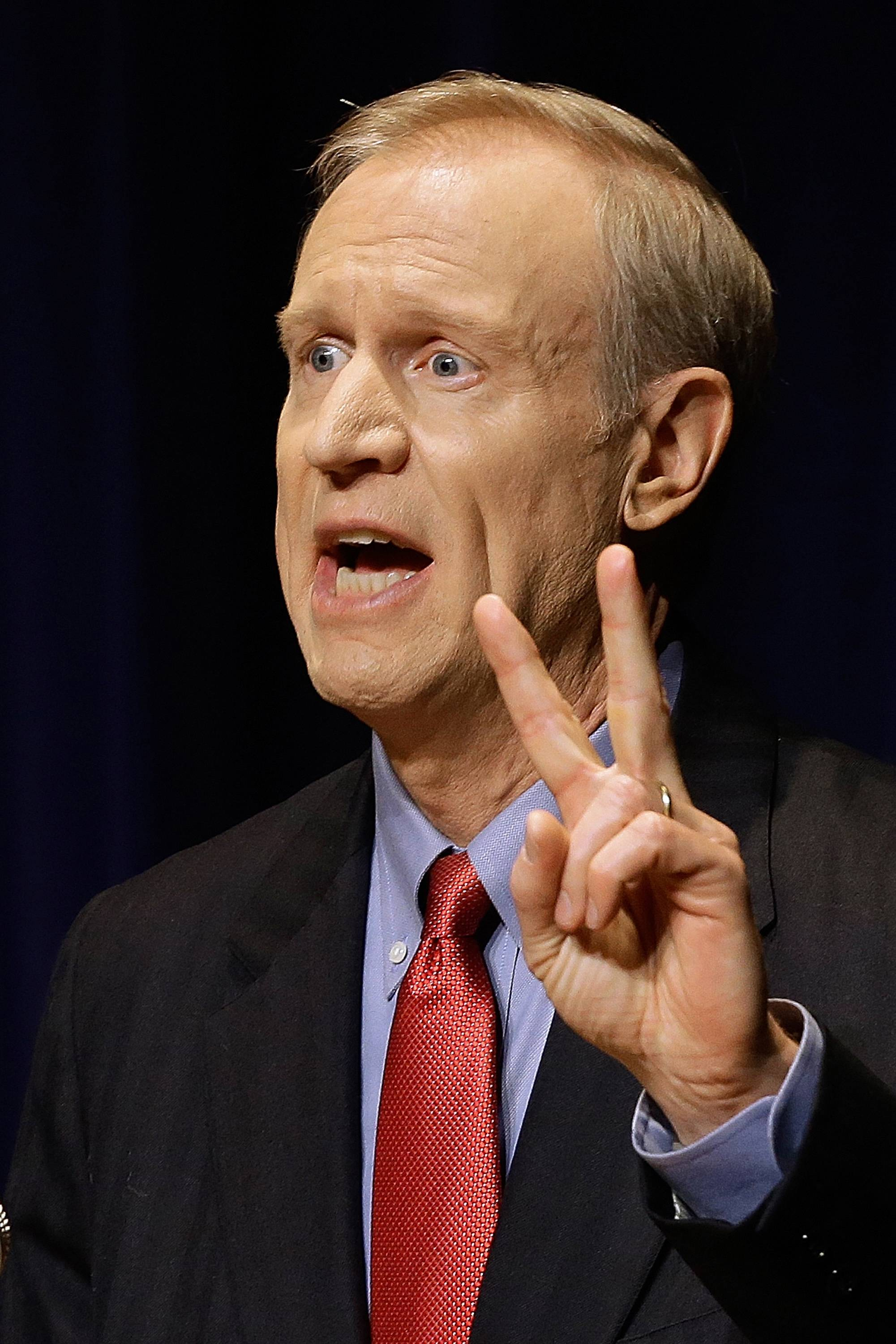 Republican gubernatorial candidate Bruce Rauner participates in a debate earlier this month in Springfield. His rivals have accused of him using his influence to get his daughter admitted to an elite Chicago public school.