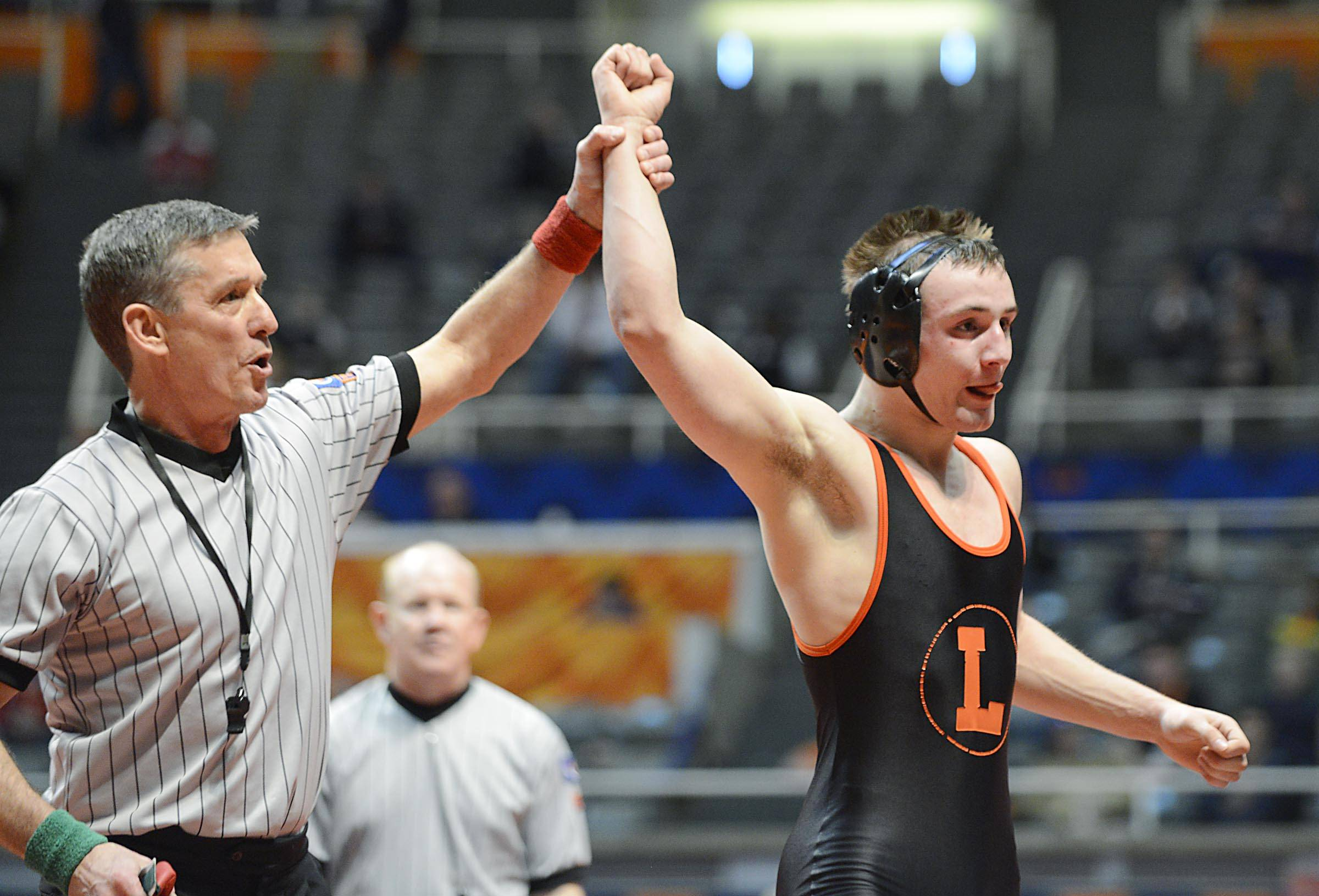 Libertyville's Joey Gunther is declared the winner against Keone Derain of St. Charles East Friday in quarterfinals of the 152-pound weight class of the 3A IHSA state tournament .
