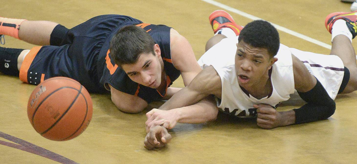 St. Charles East's Jake Clodi and Elgin's Donte Harper scramble on the floor for a loose ball in the second quarter.