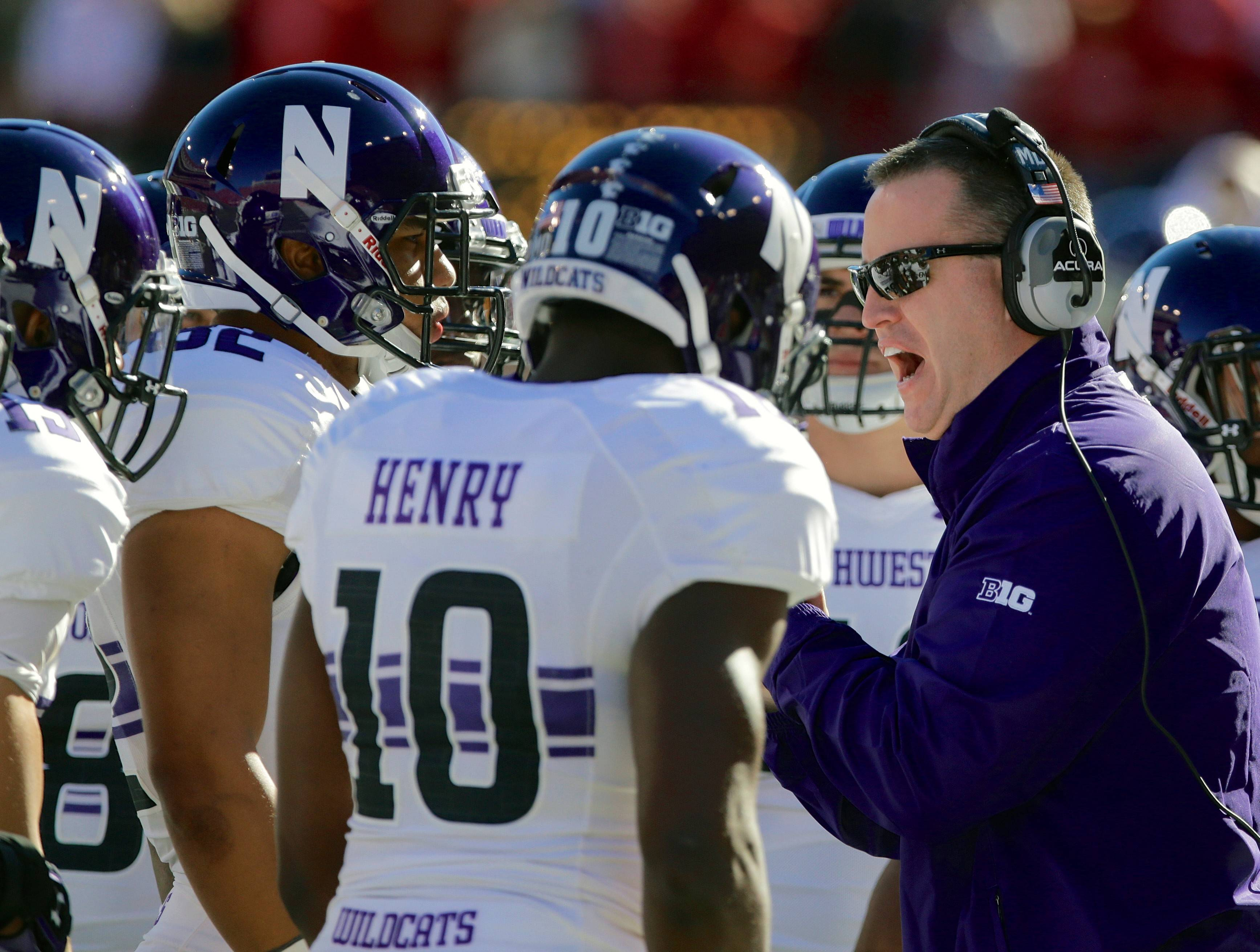 Northwestern head coach Pat Fitzgerald addresses his players in the Nebraska game last fall.
