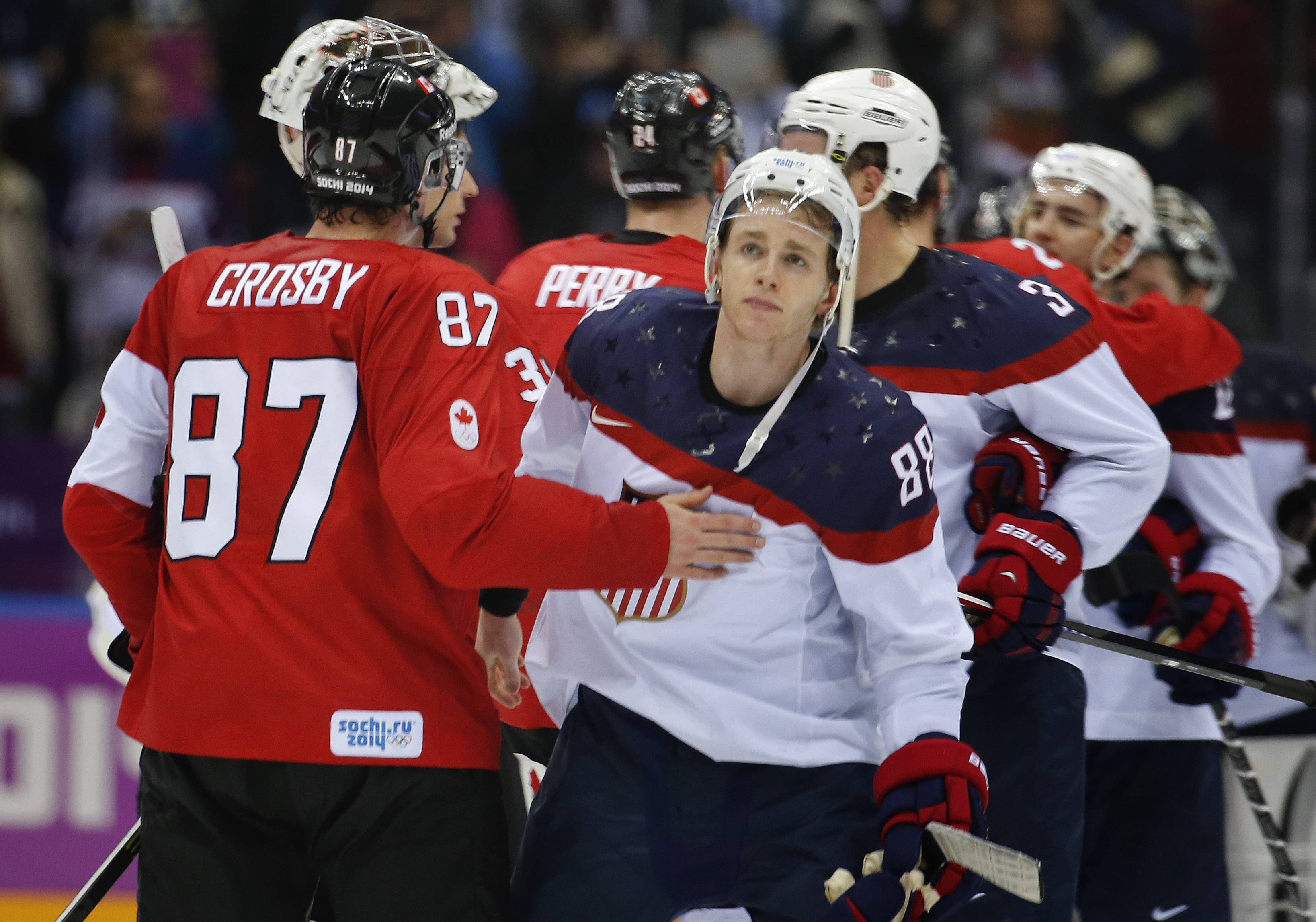 Canada forward Sidney Crosby consoles USA forward Patrick Kane after Canada won 1-0 in a men's semifinal Friday at the Sochi Olympics.