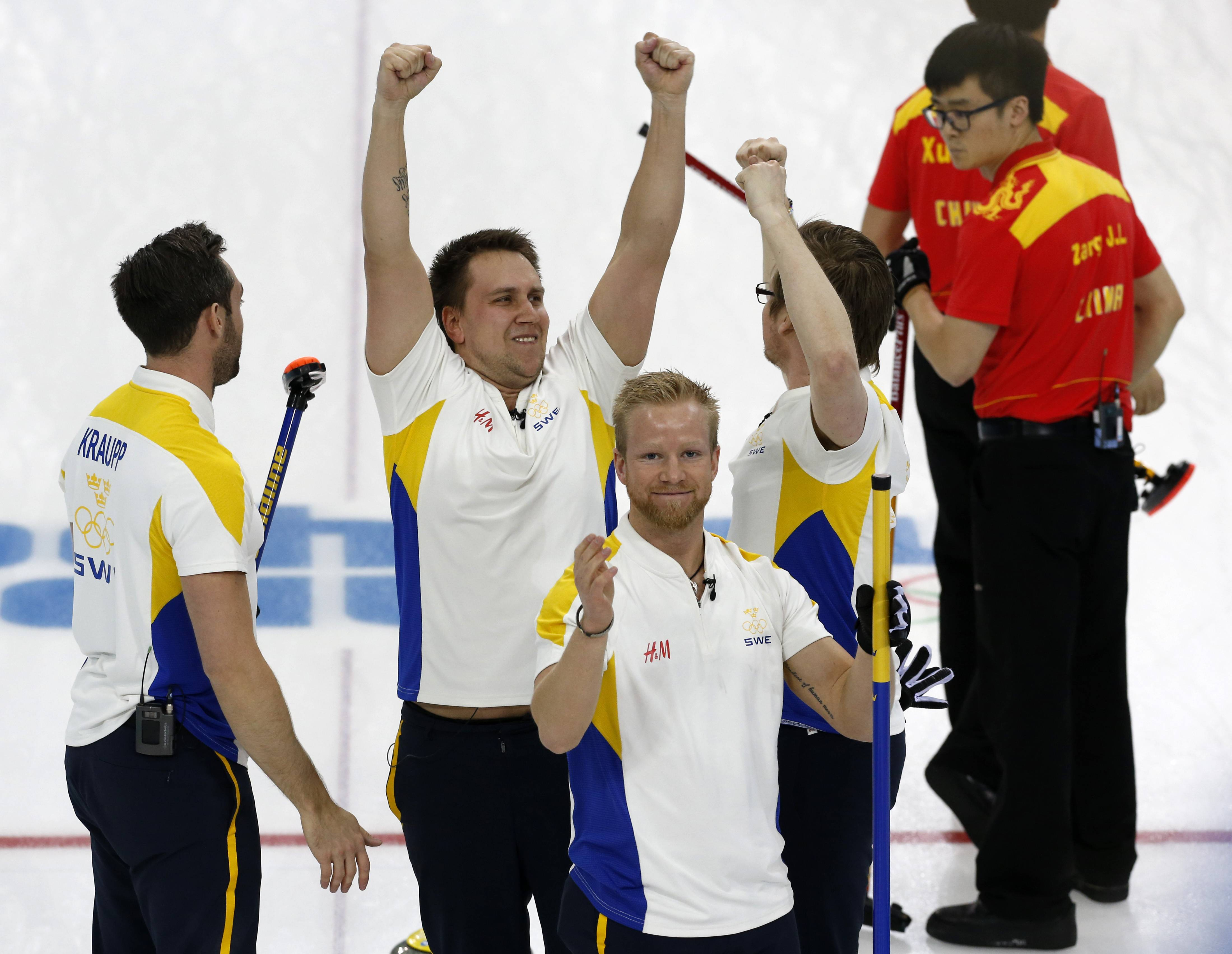 Sweden's player from left, Sebastian Kraup, Fredrik Lindberg, Niklas Edin, and Viktor Kjaell celebrate Friday following their victory over China in the men's curling bronze medal game at the 2014 Winter Olympics in Sochi, Russia.