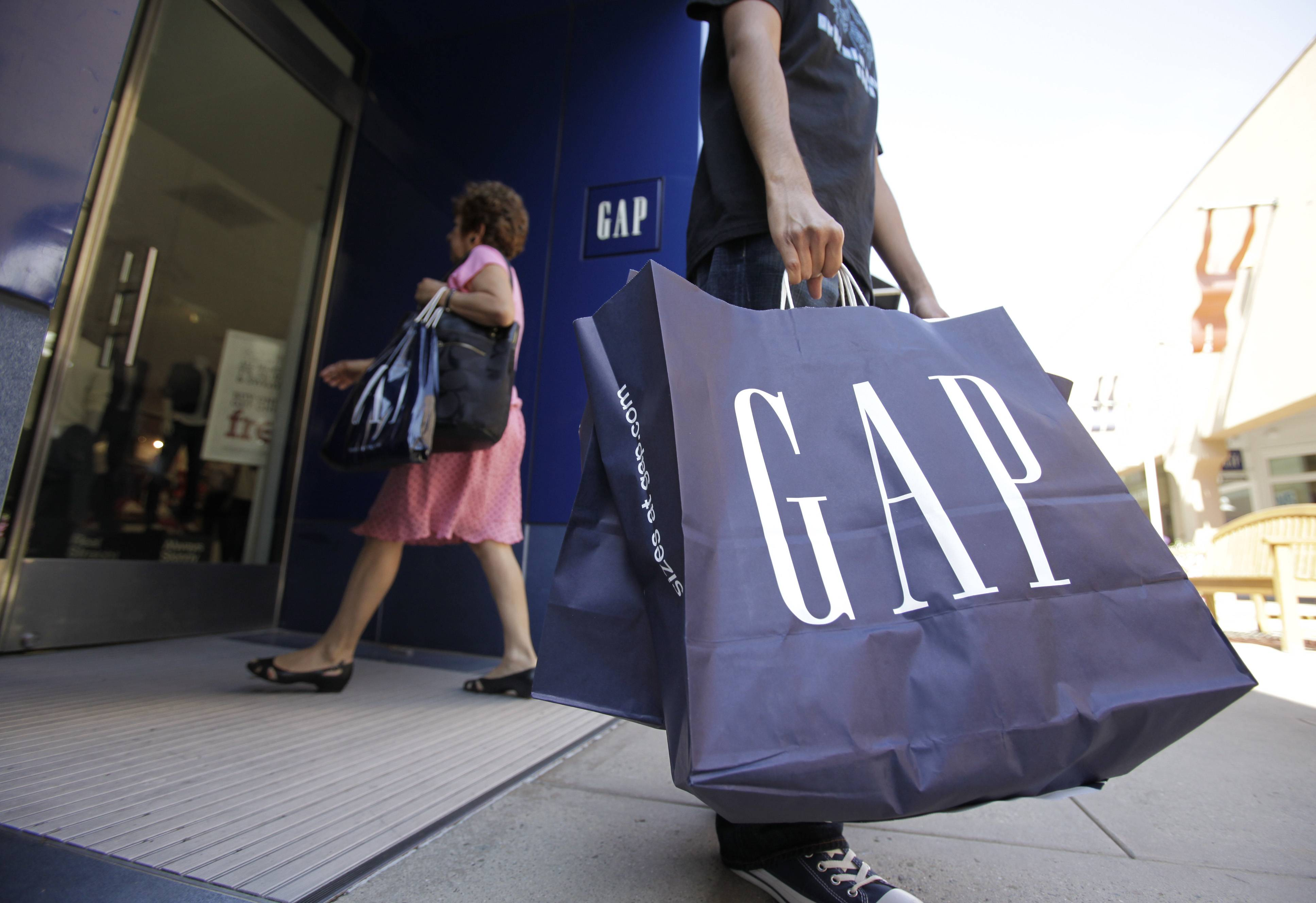 U.S. companies including Gap Inc. and Wal-Mart Stores Inc. are caught up in the debate over raising pay -- this time an increase in the federal minimum wage.