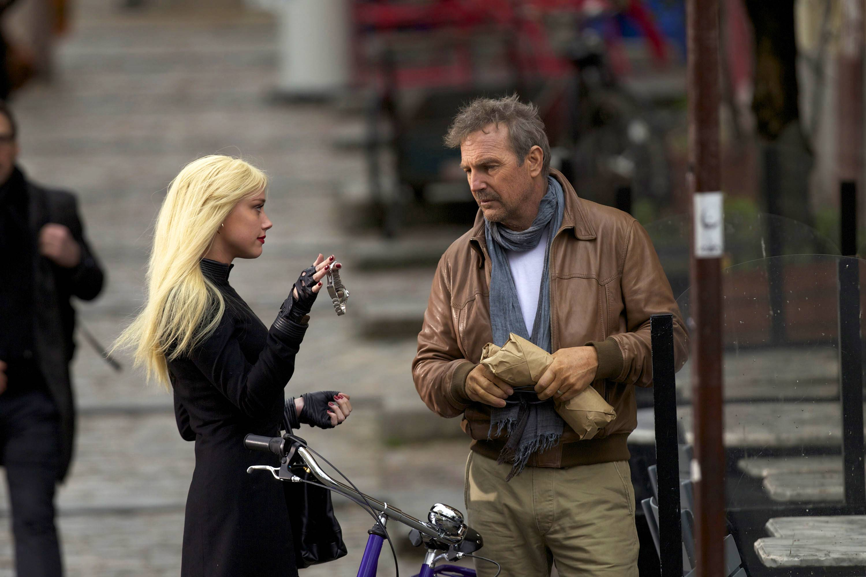 "A mysterious Vivi (Amber Heard) offers the terminally ill Ethan (Kevin Costner), a former CIA operative, an experimental cure in exchange for his services in ""3 Days to Kill."""