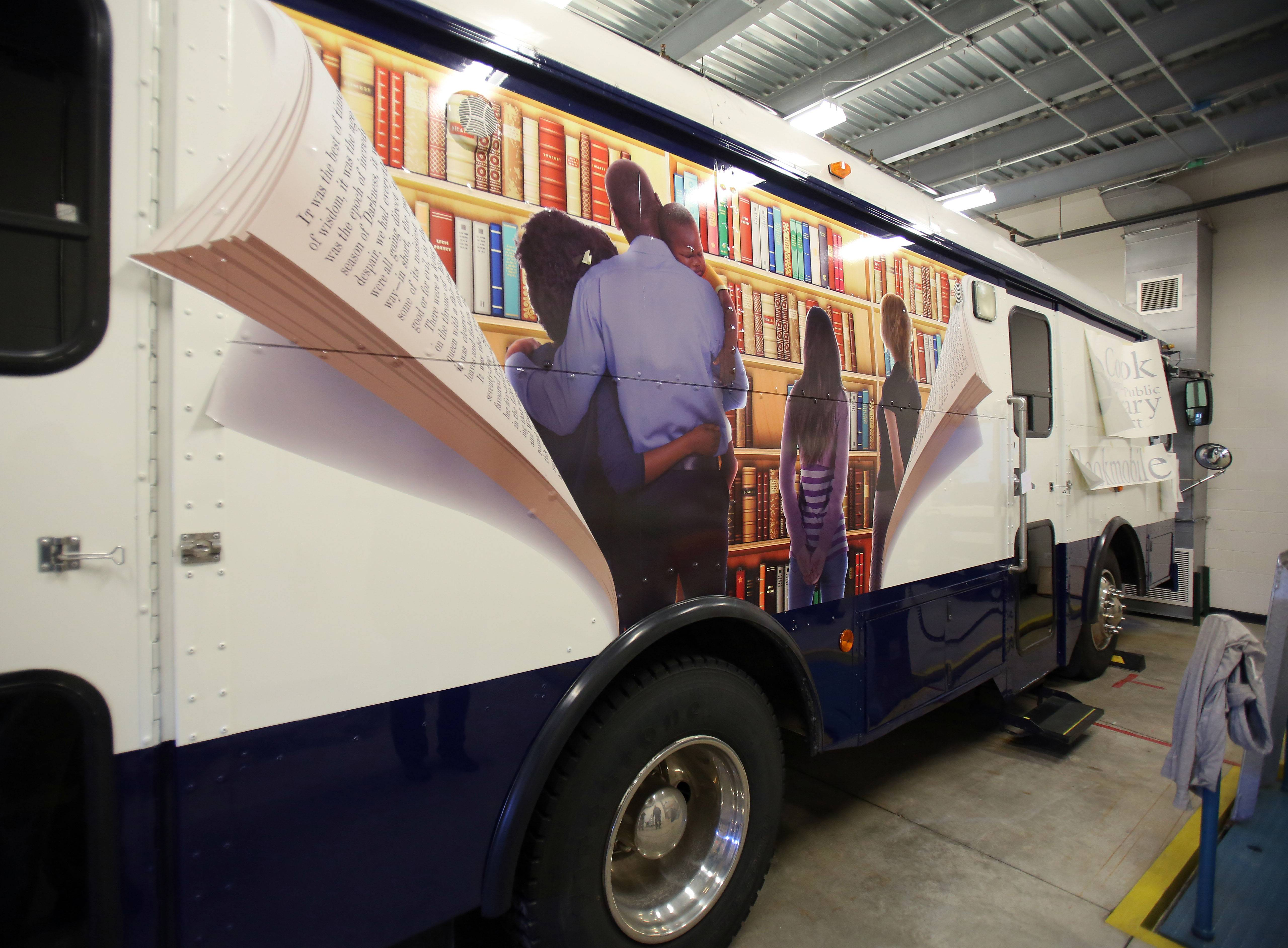 The Cook Memorial Public Library District's bookmobile got a new decorative wrap Friday, thanks to a donation from a community group that supports the library.